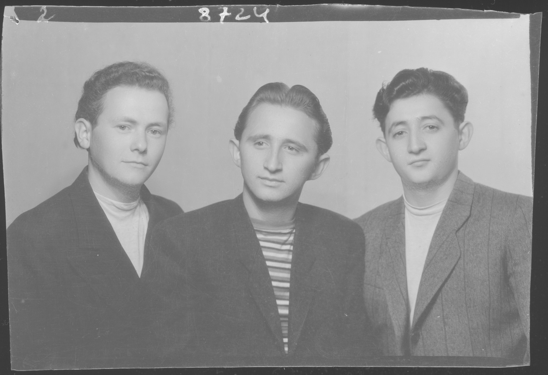 Studio portrait of Zolta Grunfeld and two other young men.