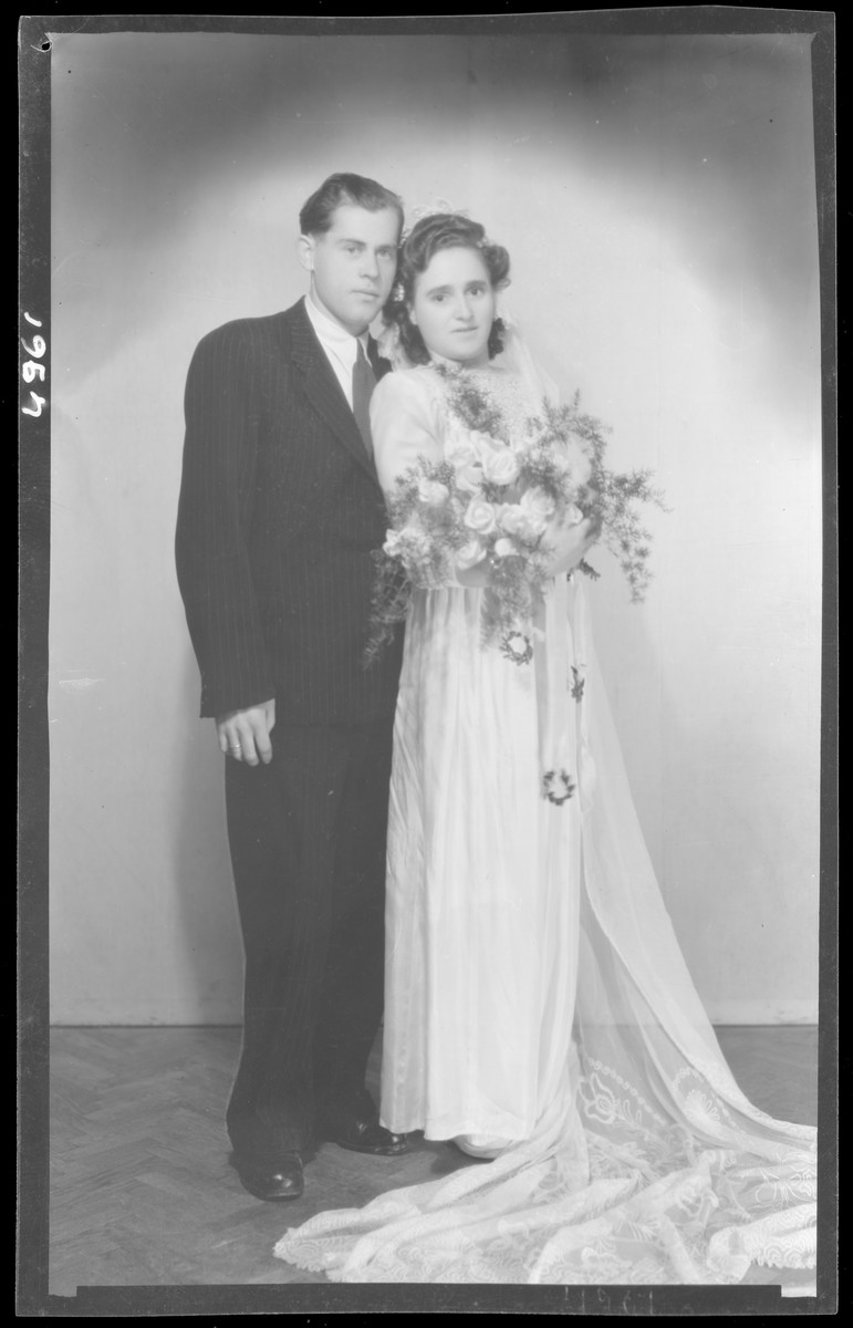 Studio wedding portrait of Albert Grunvald and his bride Sarah Klein.