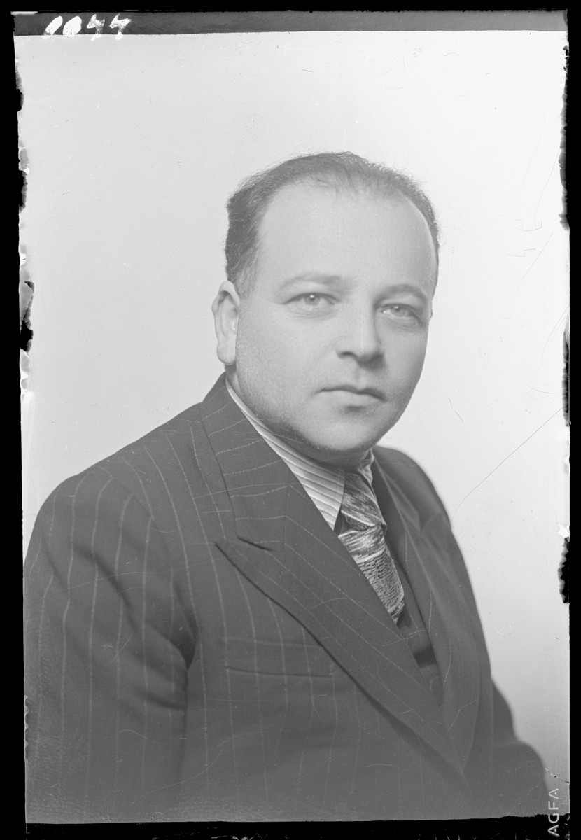 Studio portrait of Adolf Gluck.