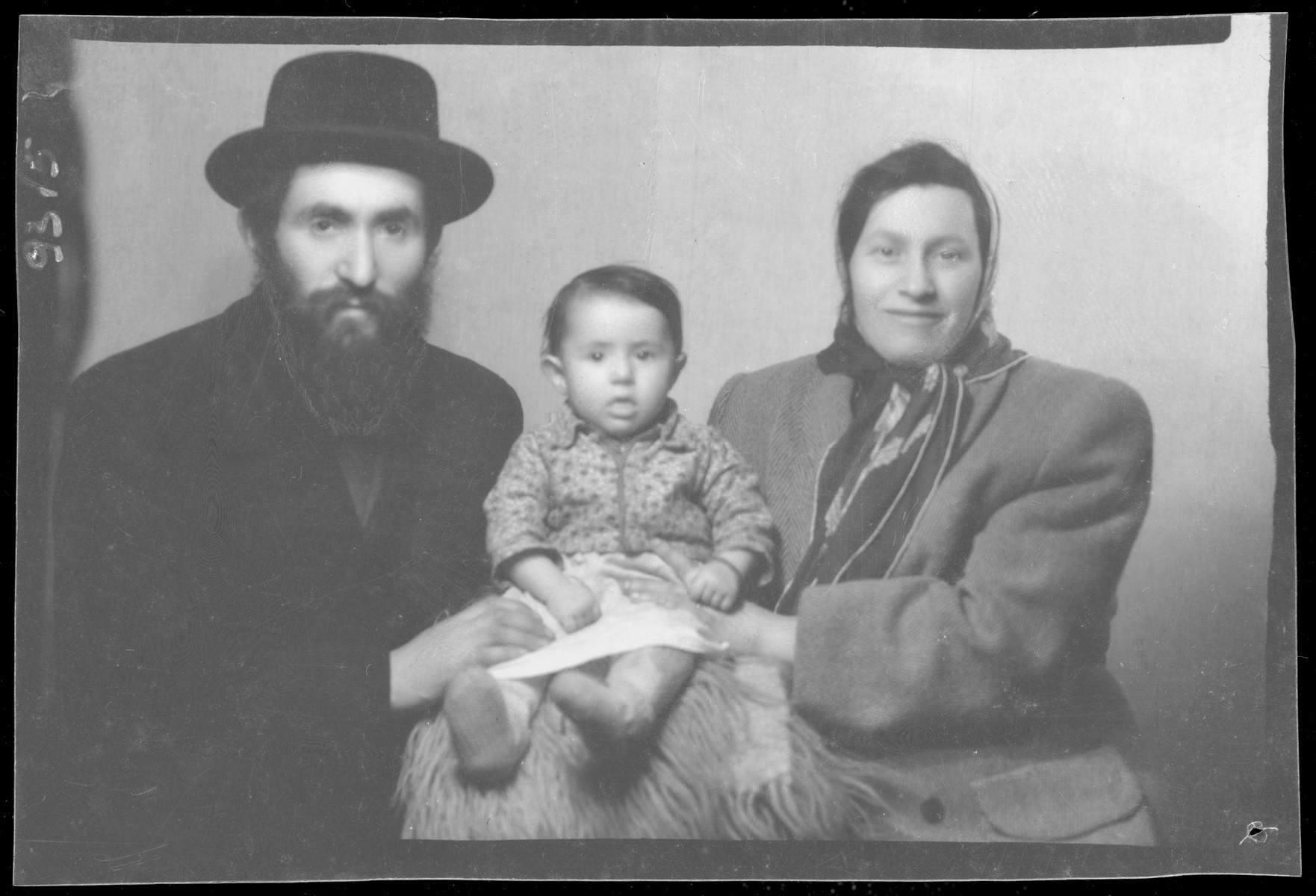 Studio portrait of Salamon Geriner, his wife and child.