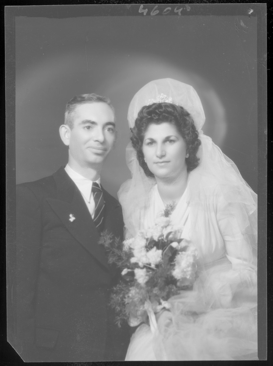 Studio wedding portrait of Dezne Grunberger and his bride.