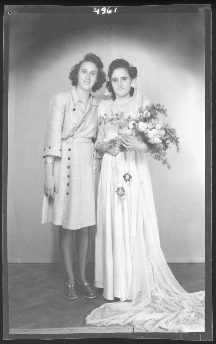 Studio portrait of the bride of Albert Grunwald and her sister.  Irina Klein is pictured on the left iand the bride is Sarah Klein Grunwald.