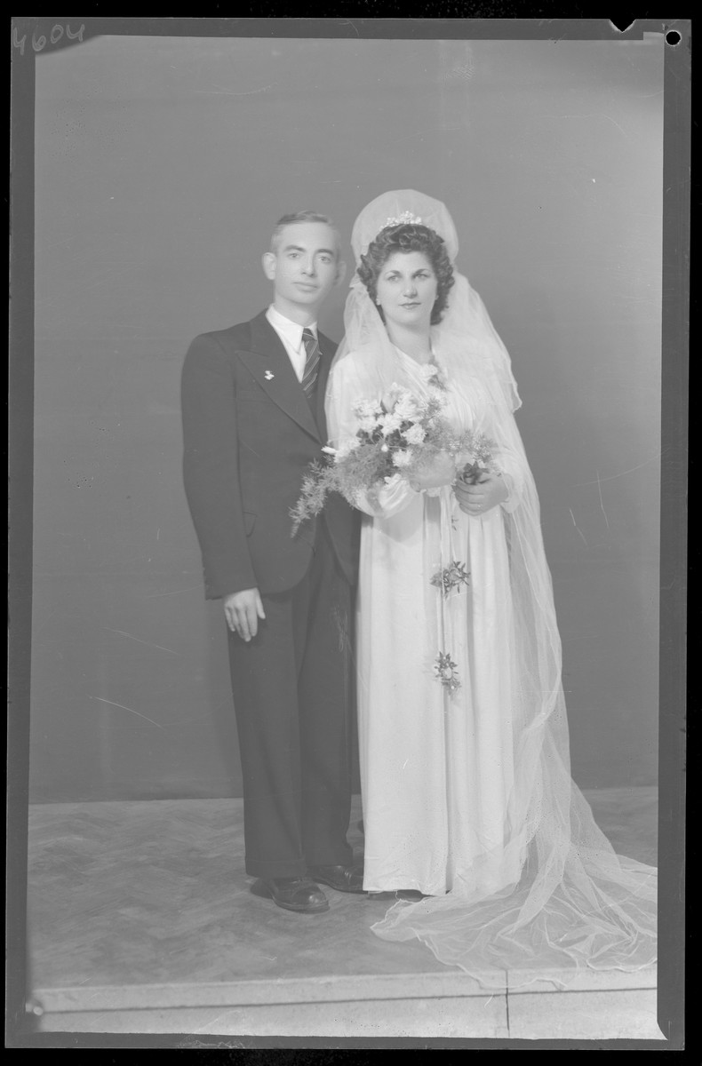 Studio portrait of Dezne Grunberger and his bride.