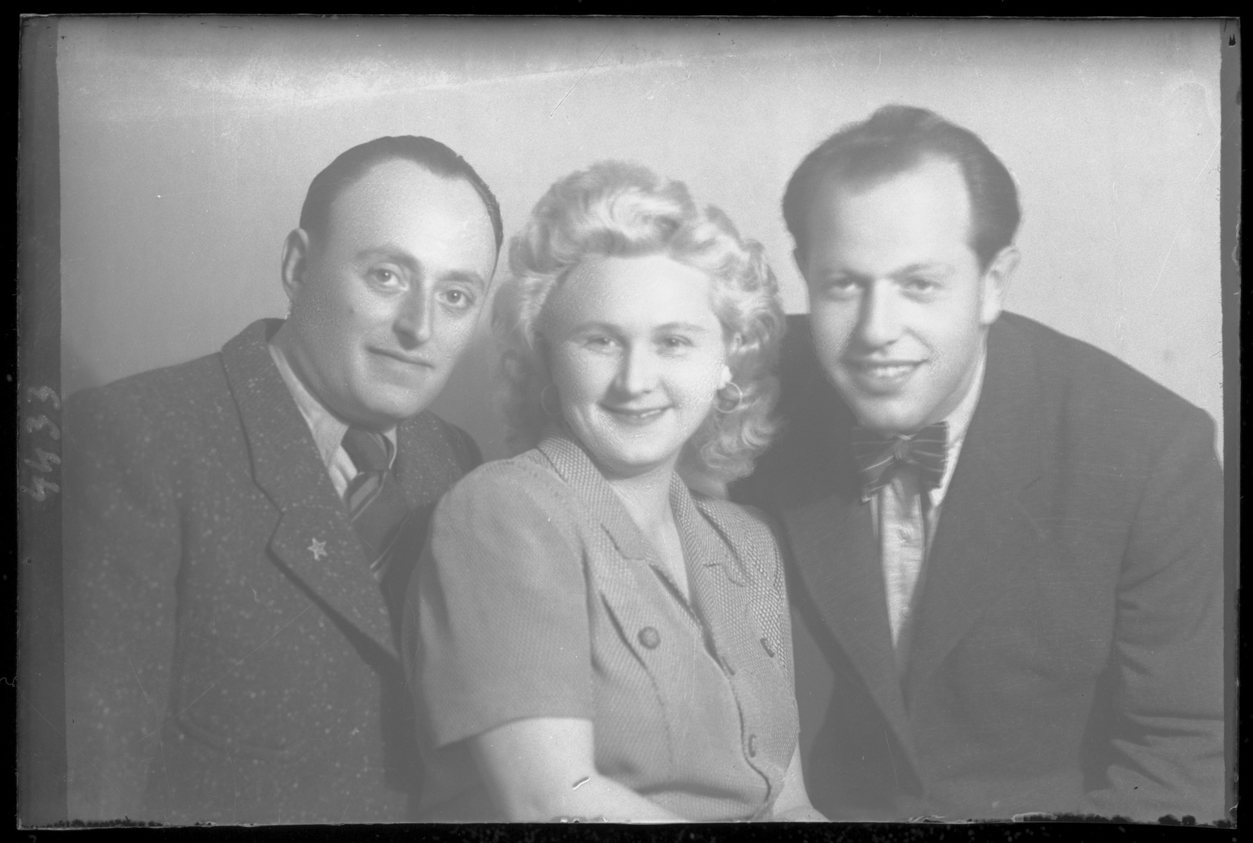 Studio portrait of Artur Grunberger and two other people.