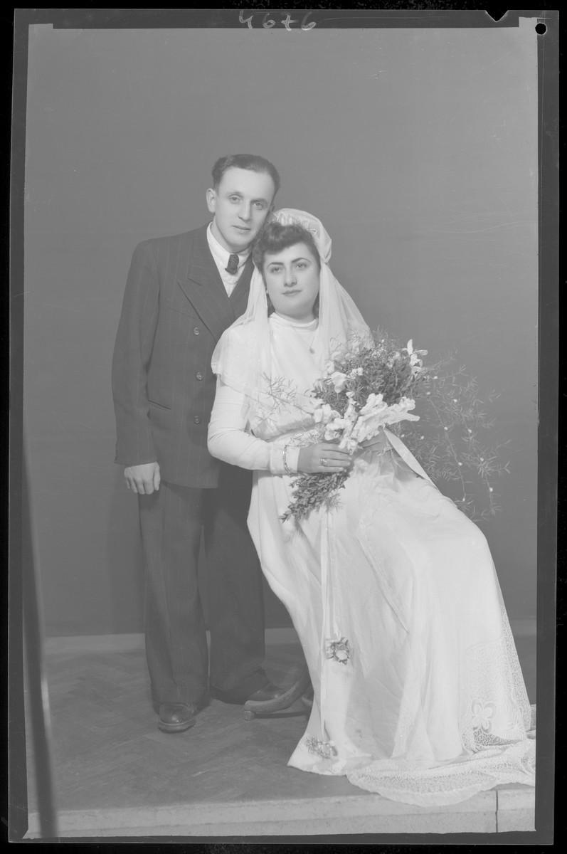 Studio wedding portrait of Miklos Grun and his bride.