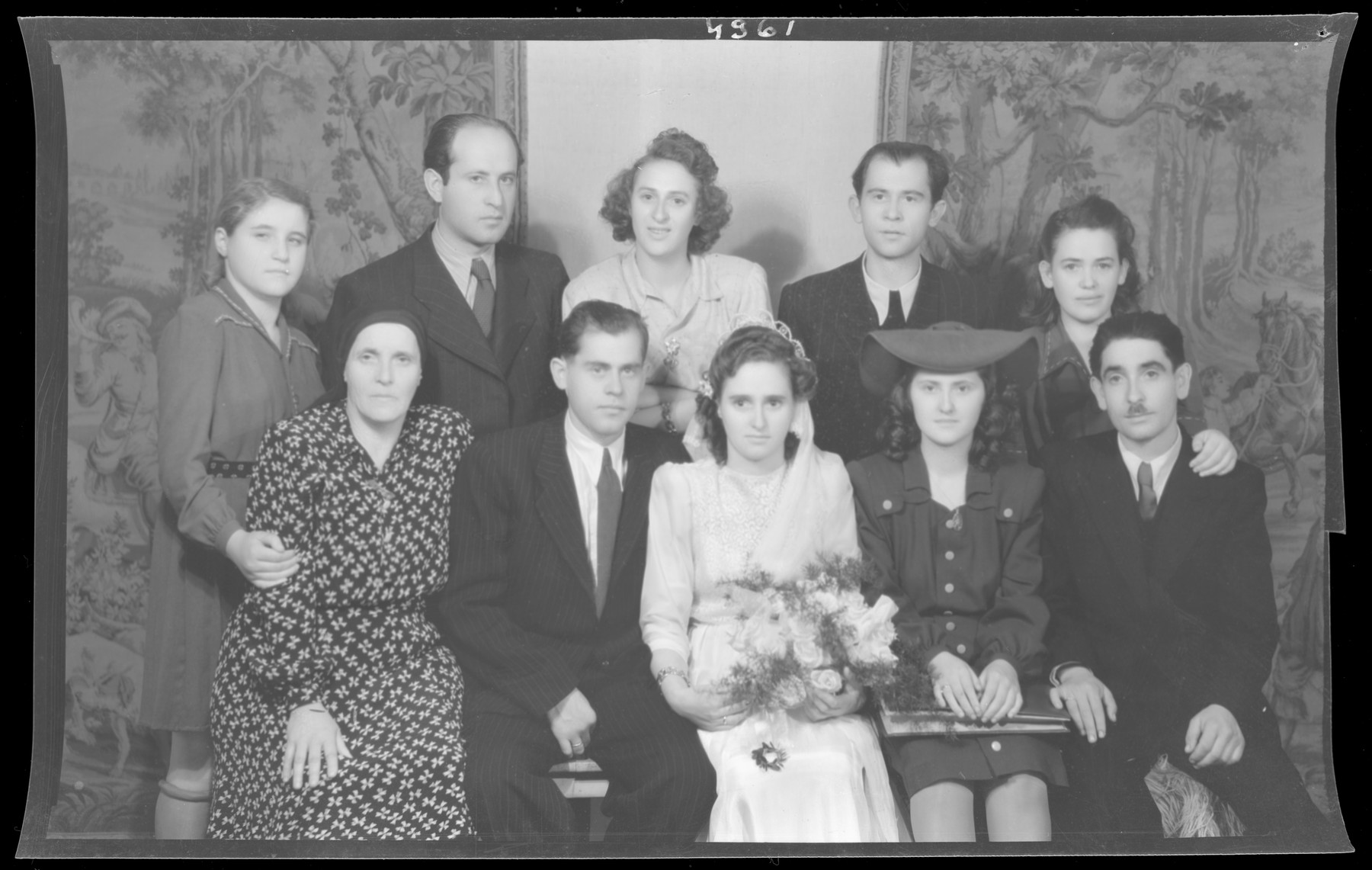 Studio group portrait of the wedding of Albert and Sara Grunwald.  Behind them are Kalman and Irina Grunwald.