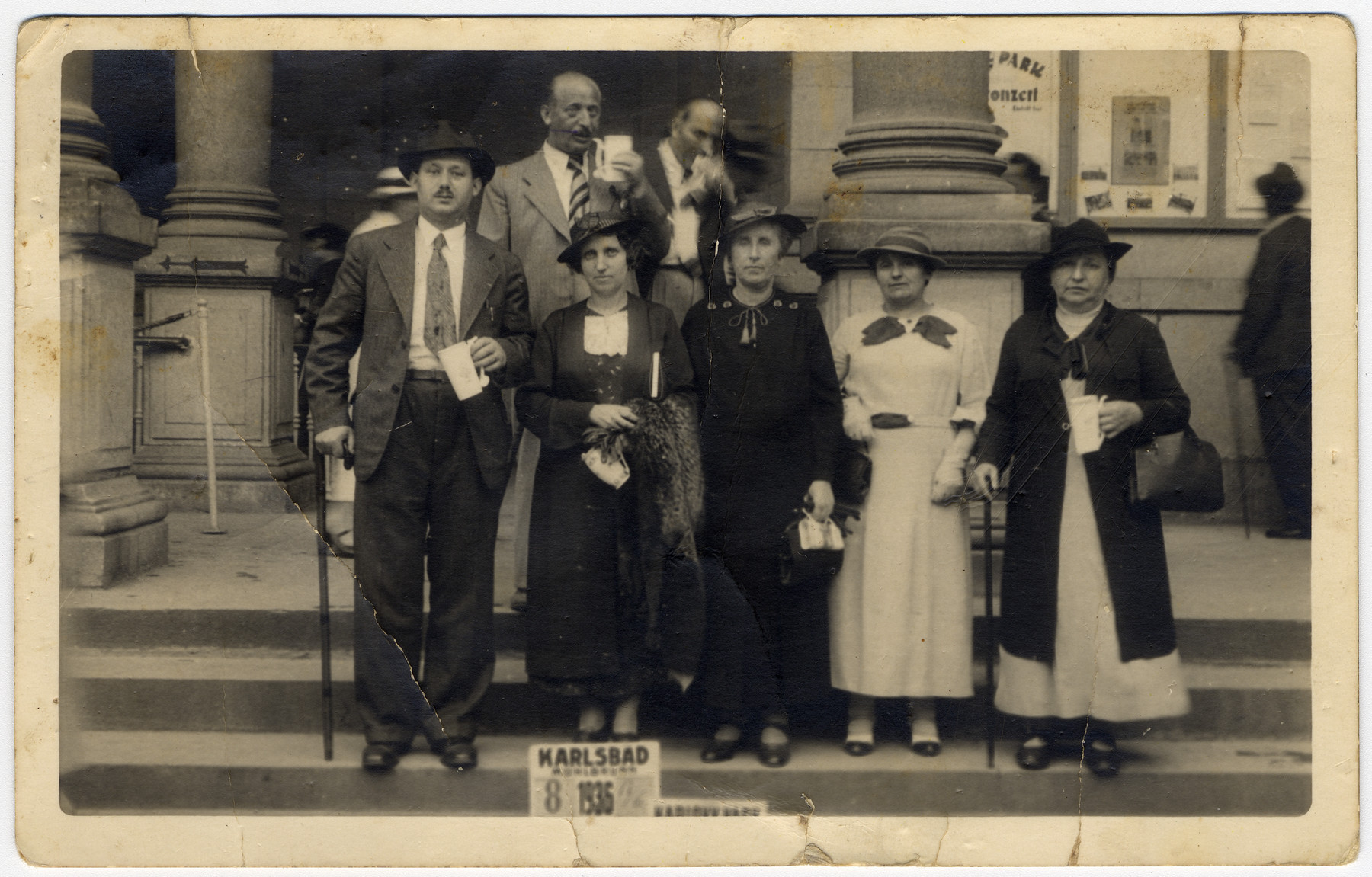 Group portrait of Jewish vacationers posing with glasses of mineral water at a spa in Karlsbad.   Pictured are members of the Lamm Schlesinger family (donor's maternal family).