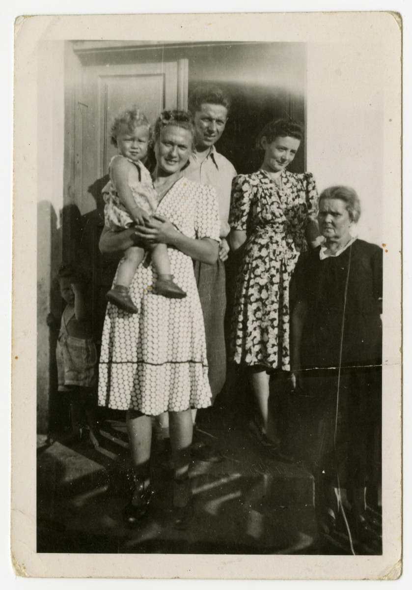 An intermarried Polish-Jewish couple, Bronka and Zygmunt Zybert, pose with their son Andrzej, Zygmunt's sister, Jadwiga Hertman, and Zygmunt's mother.   Zygmunt and Jadwiga were awarded the title of Righteous among the Nations by Yad Vashem.
