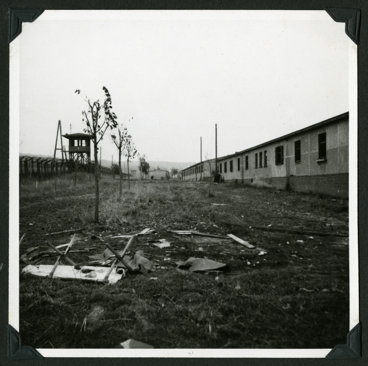 "View of the Ziegenhain displaced persons camp.  The original caption reads: ""Ziegenhain.  Guard tower and barbed wire serve to remind Jewish refugees that they are not 'home' yet."""