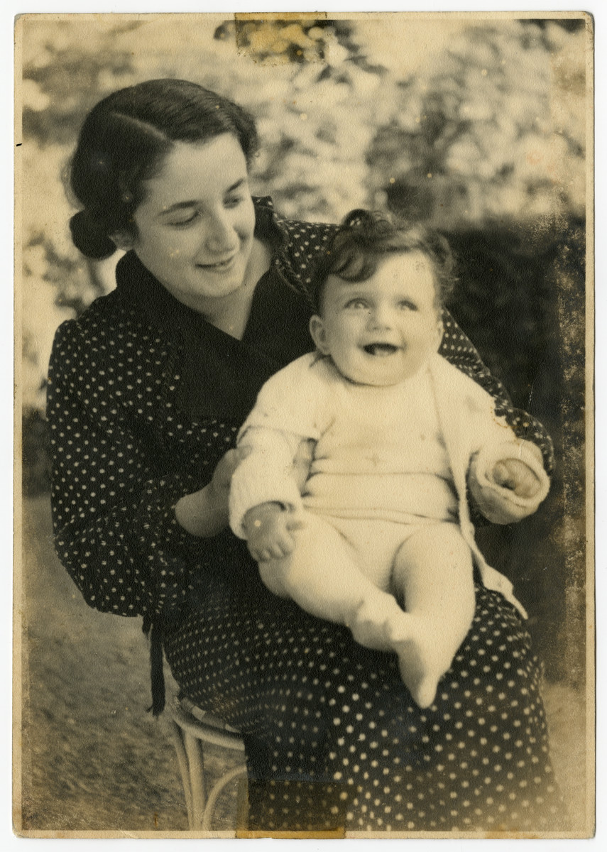 Dora Tennenbaum holds her baby Edith on her lap.