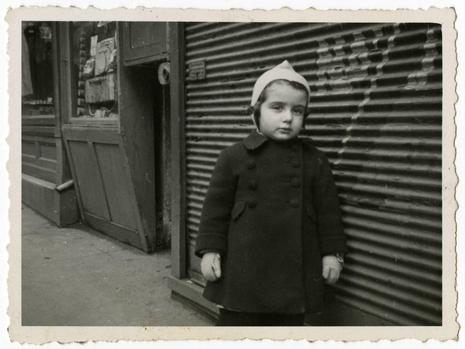 Edith Ostern stands in front of a boarded up building in Vienna.