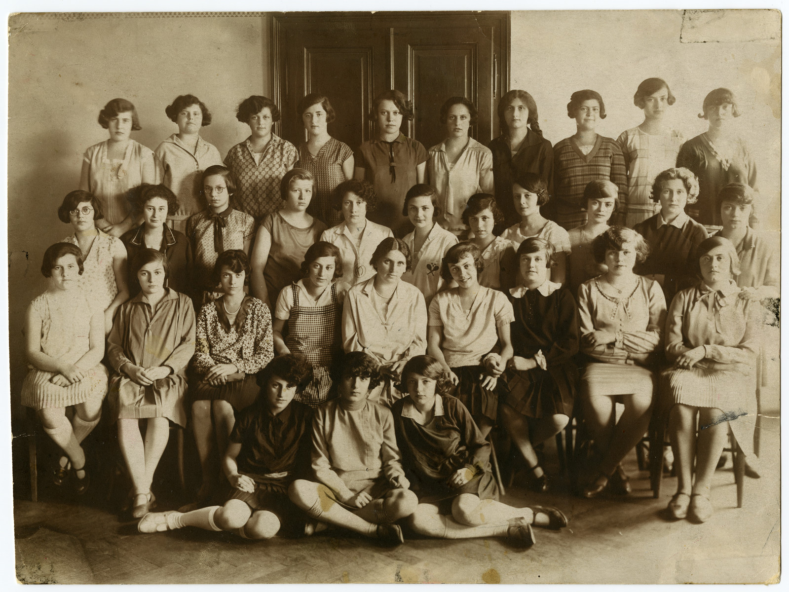 Group portrait of teenage girls in a school in Vienna.  Dora Austein in pictured in the front, middle.