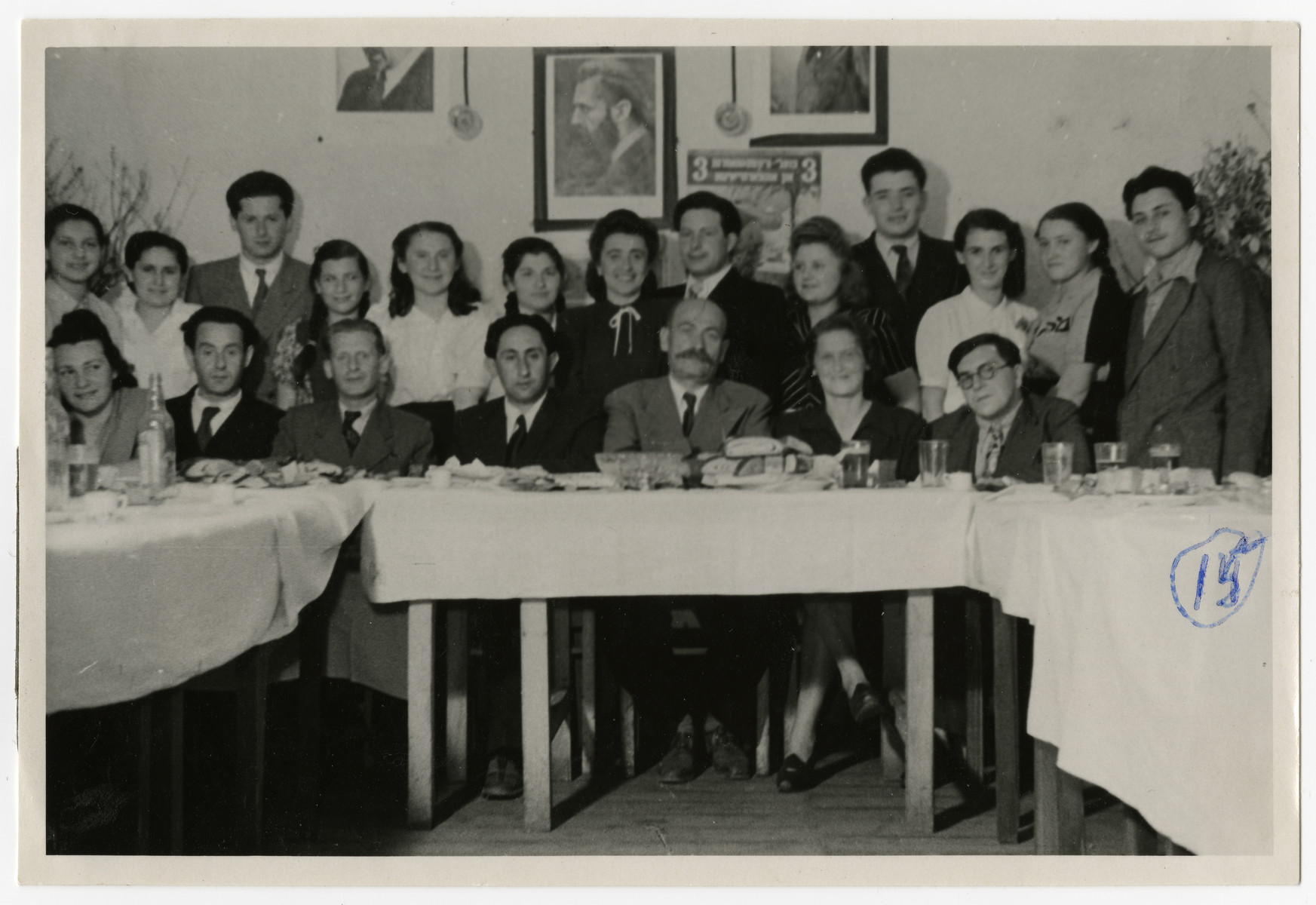 Group portrait of the teaching staff and some of the students of the Zeilsheim High School.  Among those pictured is Solomon Manischewitz, seated, second from the left, and Mr. Epstein, the principal, seated in the center.