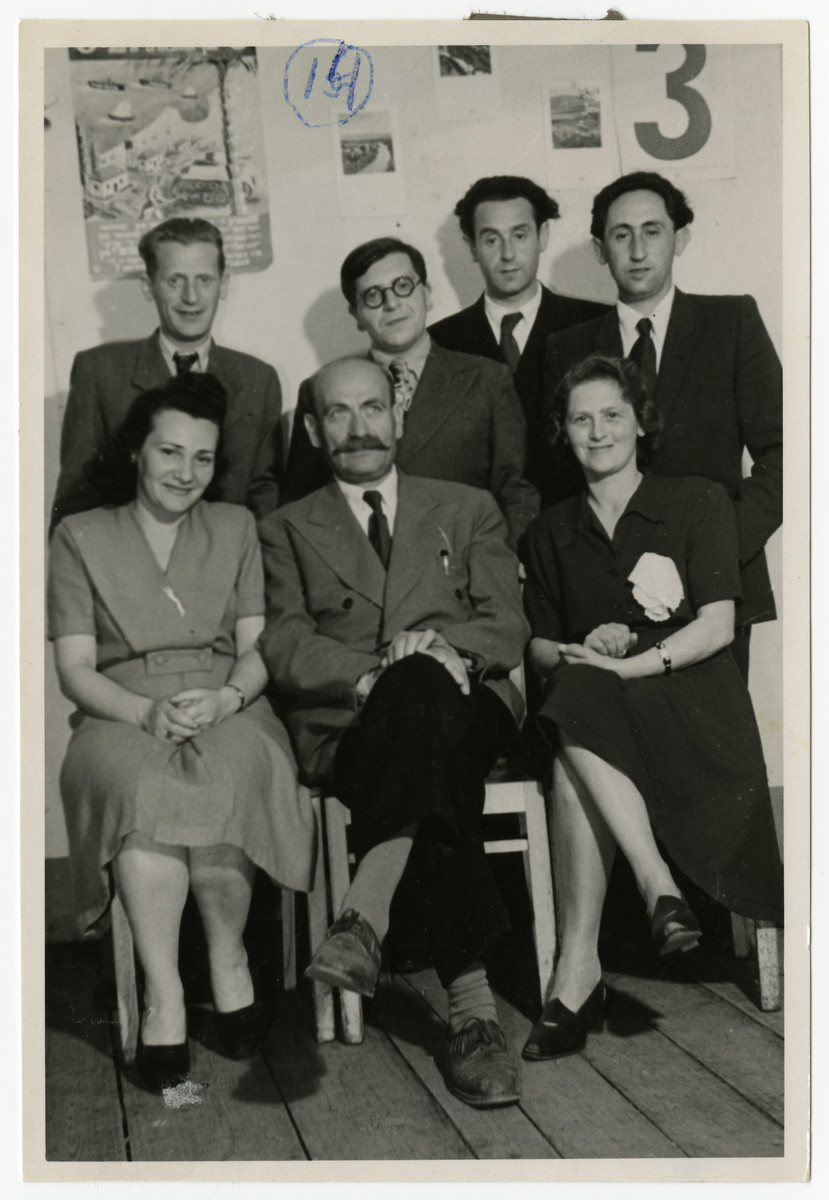 Group portrait of the teachers from the high school at the Zeilsheim DP Center.  Among those pictured are Solomon Manishewitz (the donor), standing, second from the right and Mr. Epstein, the principal of the high school, seated, in the middle.