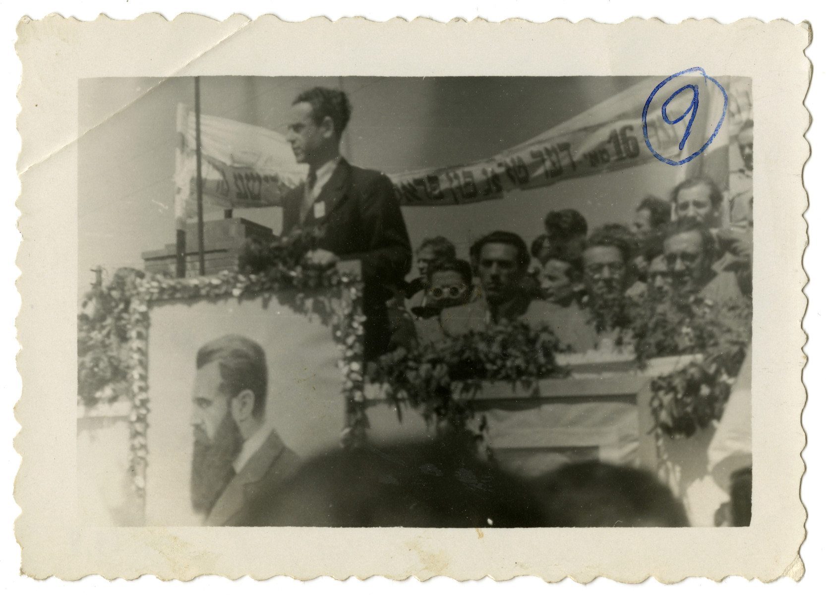 Solomon Manischewitz, the donor, speaks from a podium in front of a crowd at an assembly announcing the proclamation of the state of Israel.