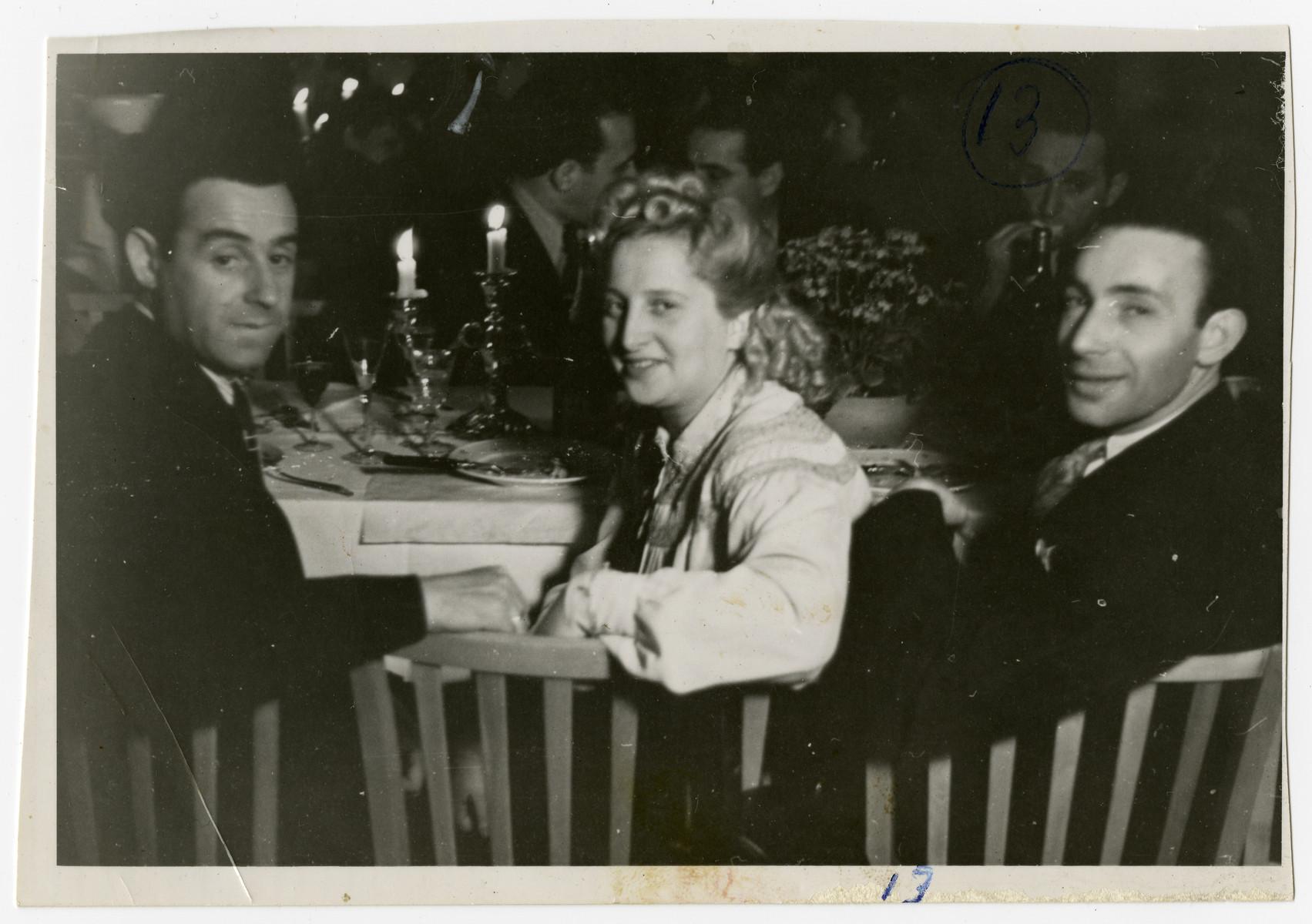 Solomon Manischewitz (left) enjoys a Shabbat dinner with his wife Sara and an unidentified friend.
