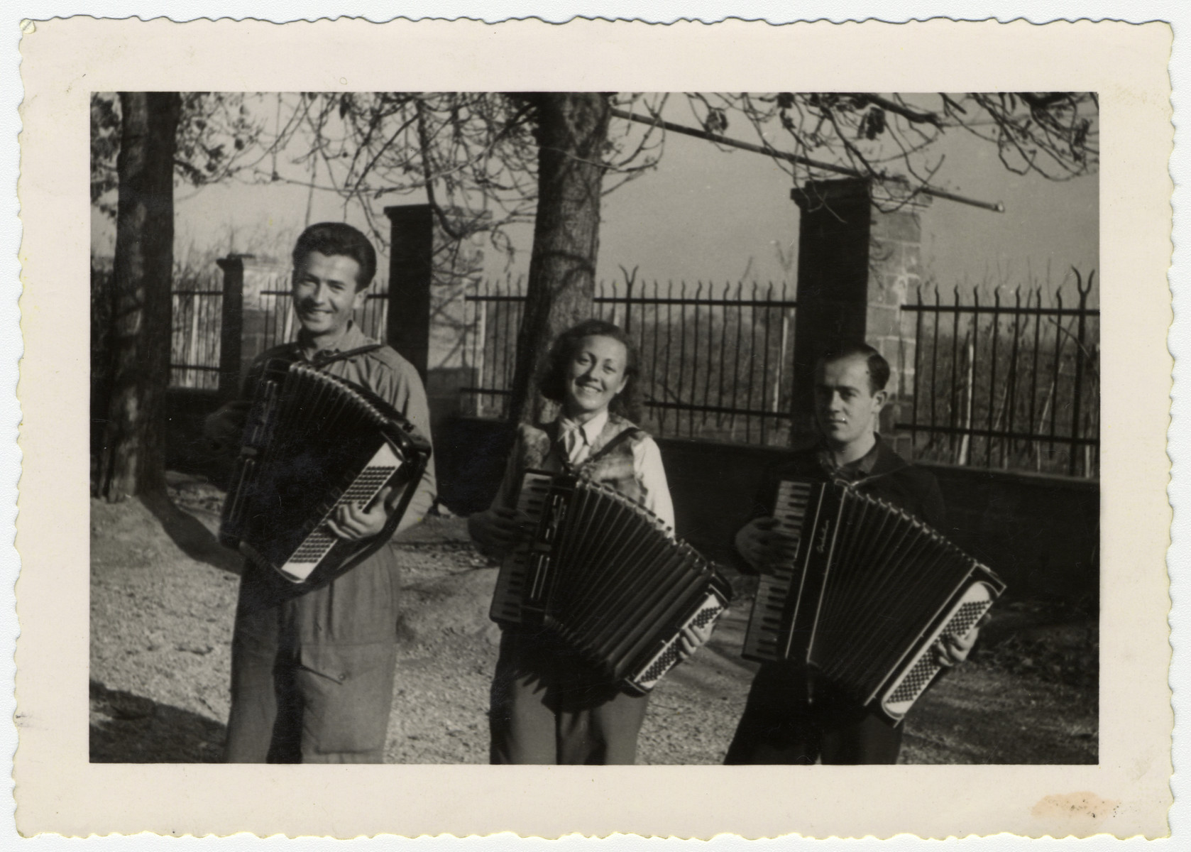 Gerta  Bagriansky and two friends play the accordion in a displaced person's camp in Graz, Austria.