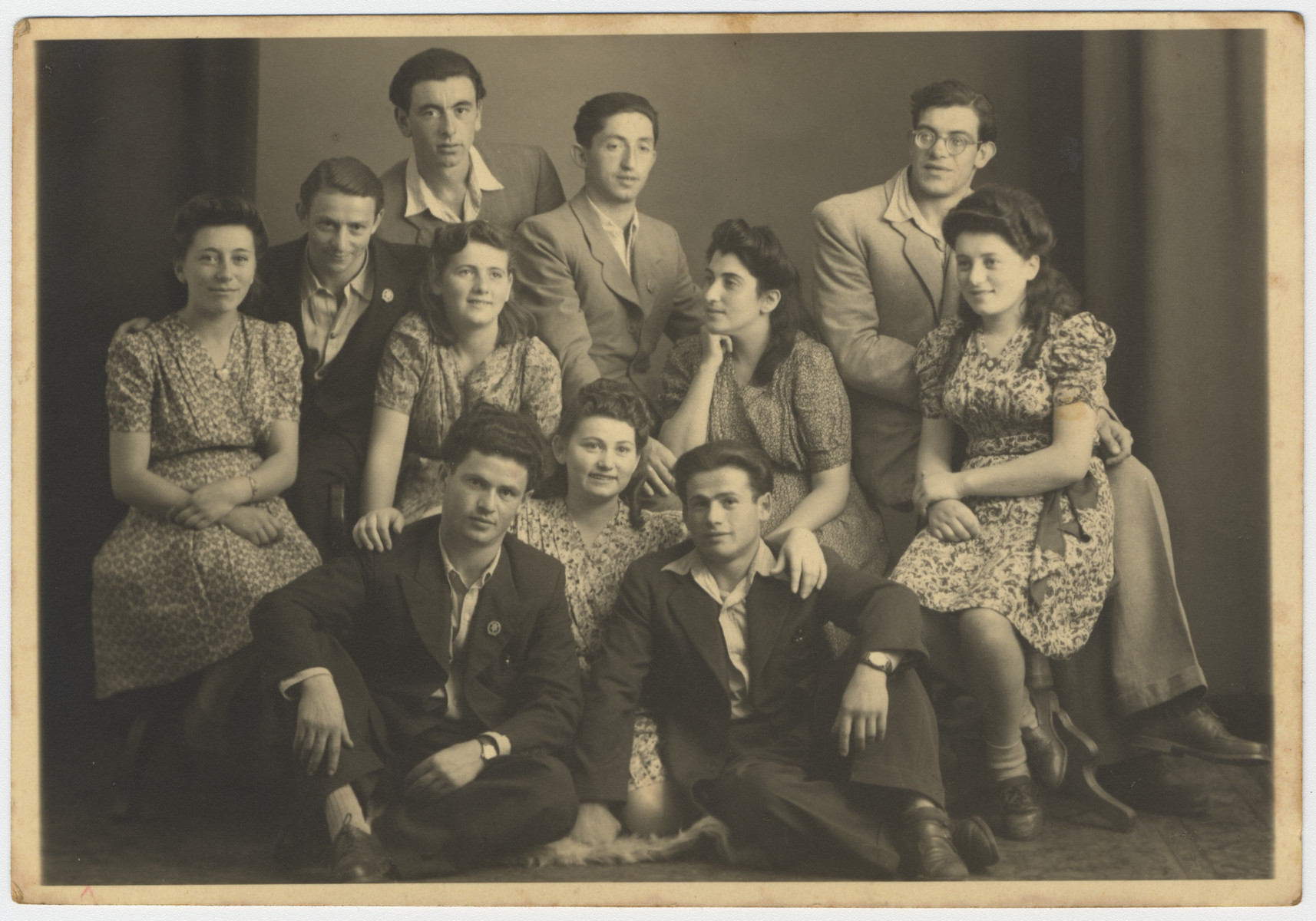 Group portrait of members of the Zionist youth movement Hashomer Hatzair in the Bergen-Belsen displaced persons' camp.  Max Schanzer is pictured in the back row, center.  Also pictured are Moshe Shapiro and Yehuda Marin.