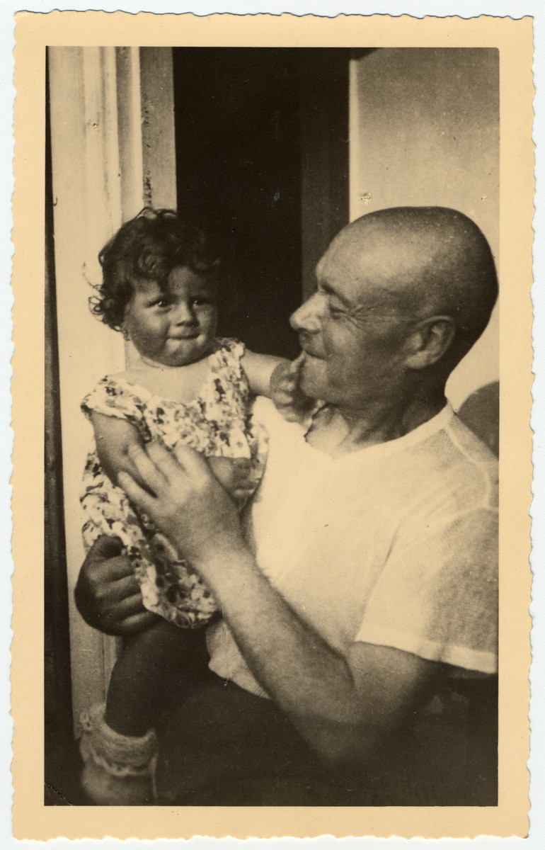 Zalman (Solomon) Bogriansky holds his young granddaughter, Rosian Bagriansky.  This is the only known photograph of Zalman Bogriansky.  He was tortured and killed during the first weeks of the Nazi occupation of Lithuania.