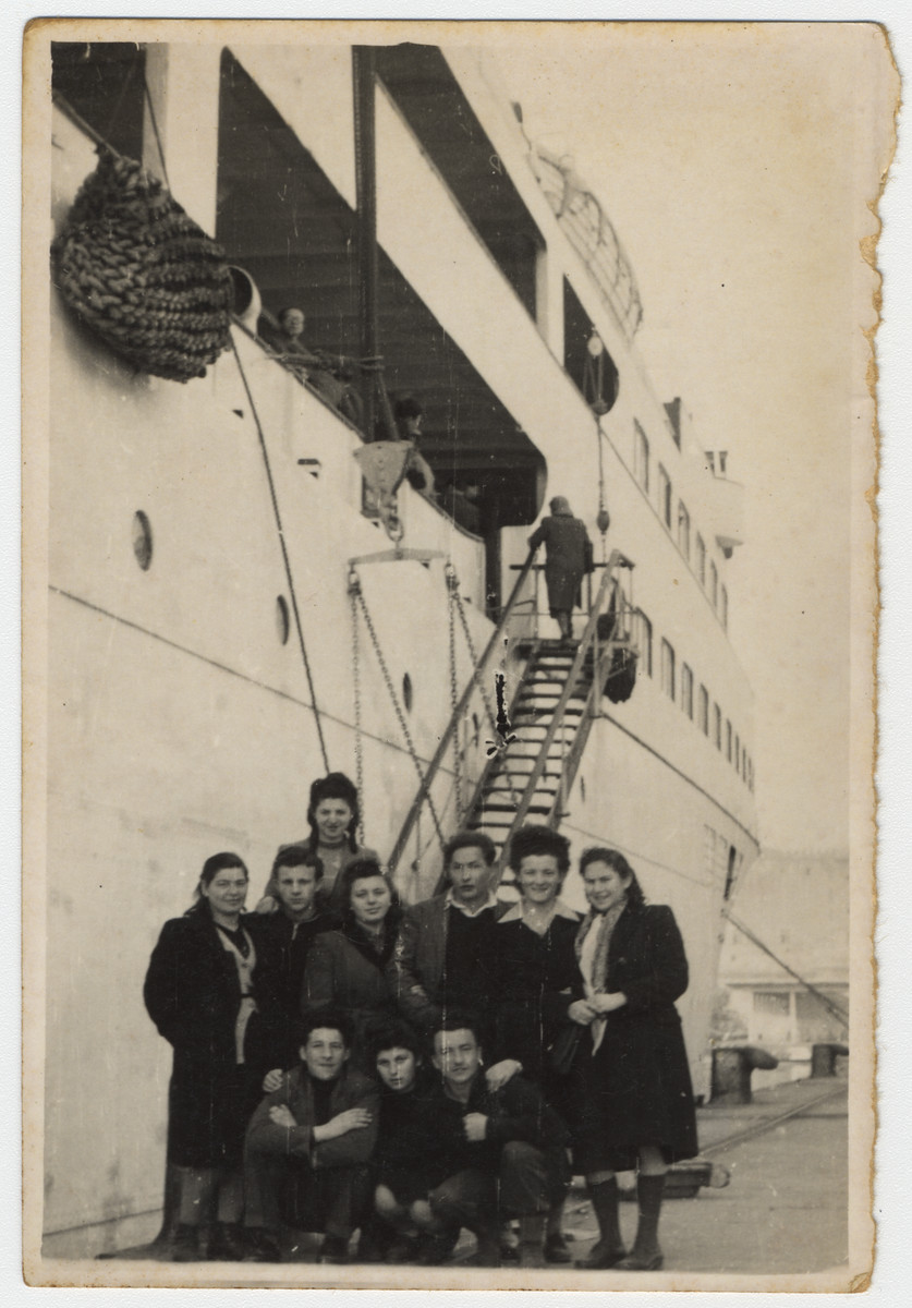"""Jewish displaced persons pose in front of the ship """"Transylvania"""" prior to their departure for Israel.  Among those pictured is Max Schanzer."""