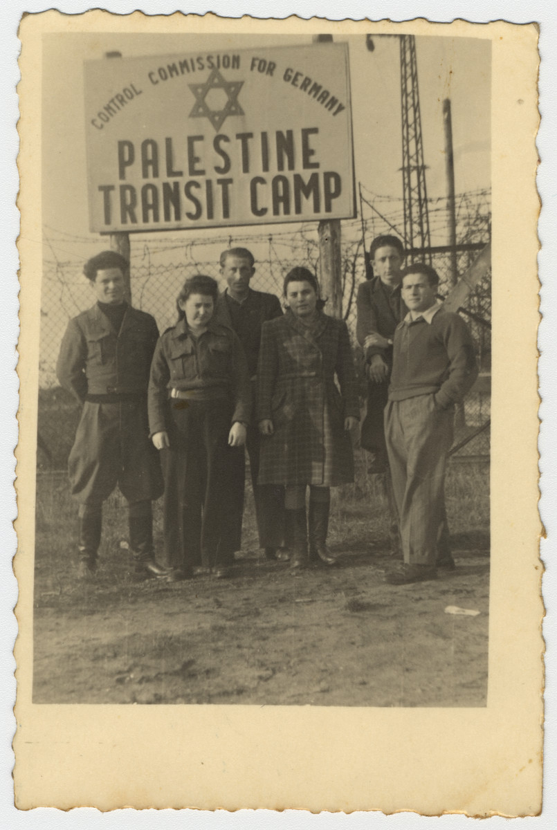 Jewish youth pose under a sign in the Palestine Transit Camp in Bocholt Germany prior to their departure for Palestine.