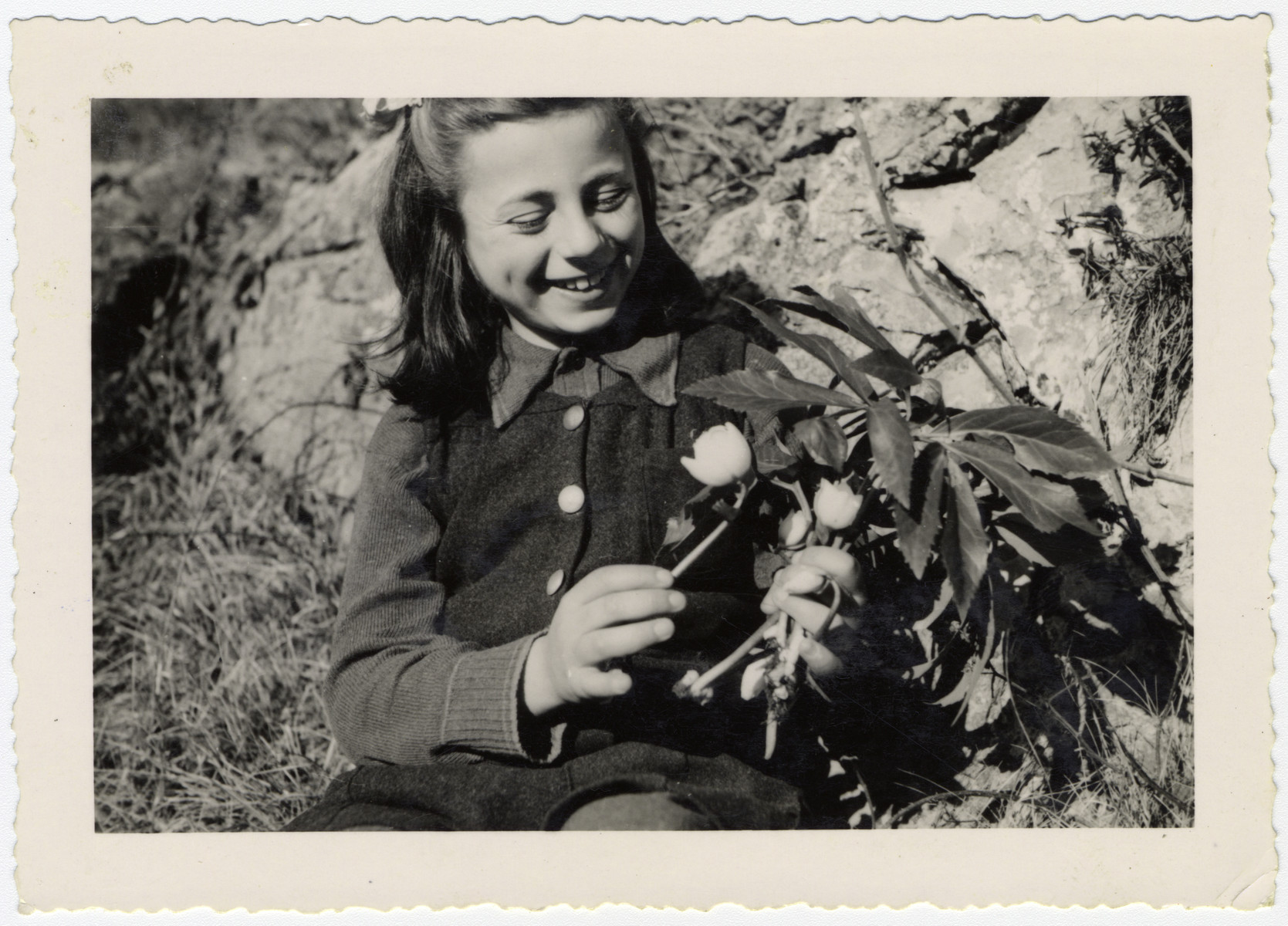 Rosian Bagriansky picks flowers on the grounds of the Selvino children's home.