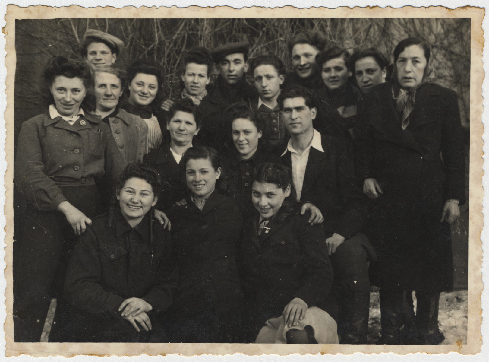 Group portrait of members of the Zionist youth movement Hashomer Hatzair in the Bergen-Belsen displaced persons' camp.  Max Schanzer is pictured in the back row, fifth from the right.