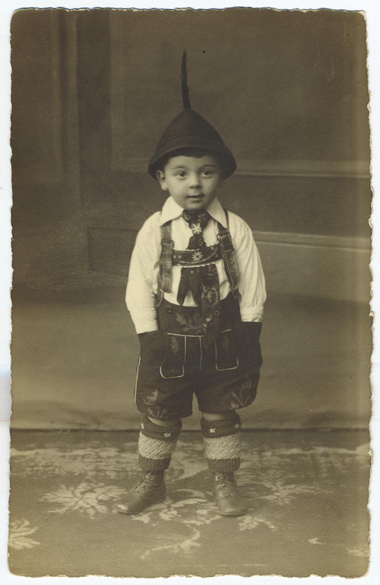 Close-up portrait of a young German-Jewish boy in Mannheim wearing lederhosen.  Pictured is Erwin Hirsch.