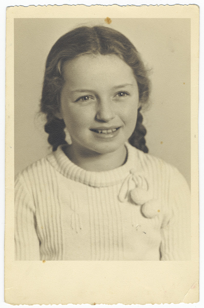 Studio portrait of a Jewish girl in Duesseldorf.  Pictured is Helga Kann.  Officially declared stateless, she probably perished in the Holocaust.