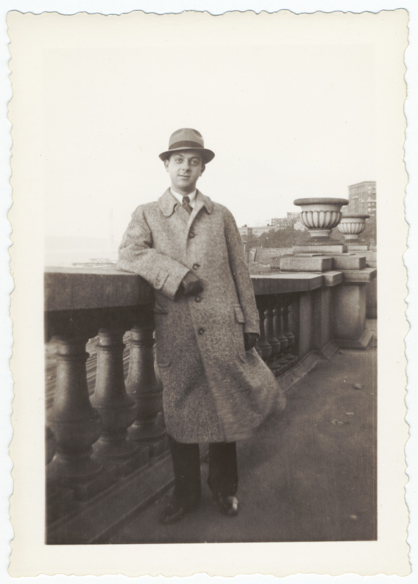 A new German-Jewish immigrant poses by a cement railing the day he arrived in New York.  Pictured is Cantor Erwin Hirsch.