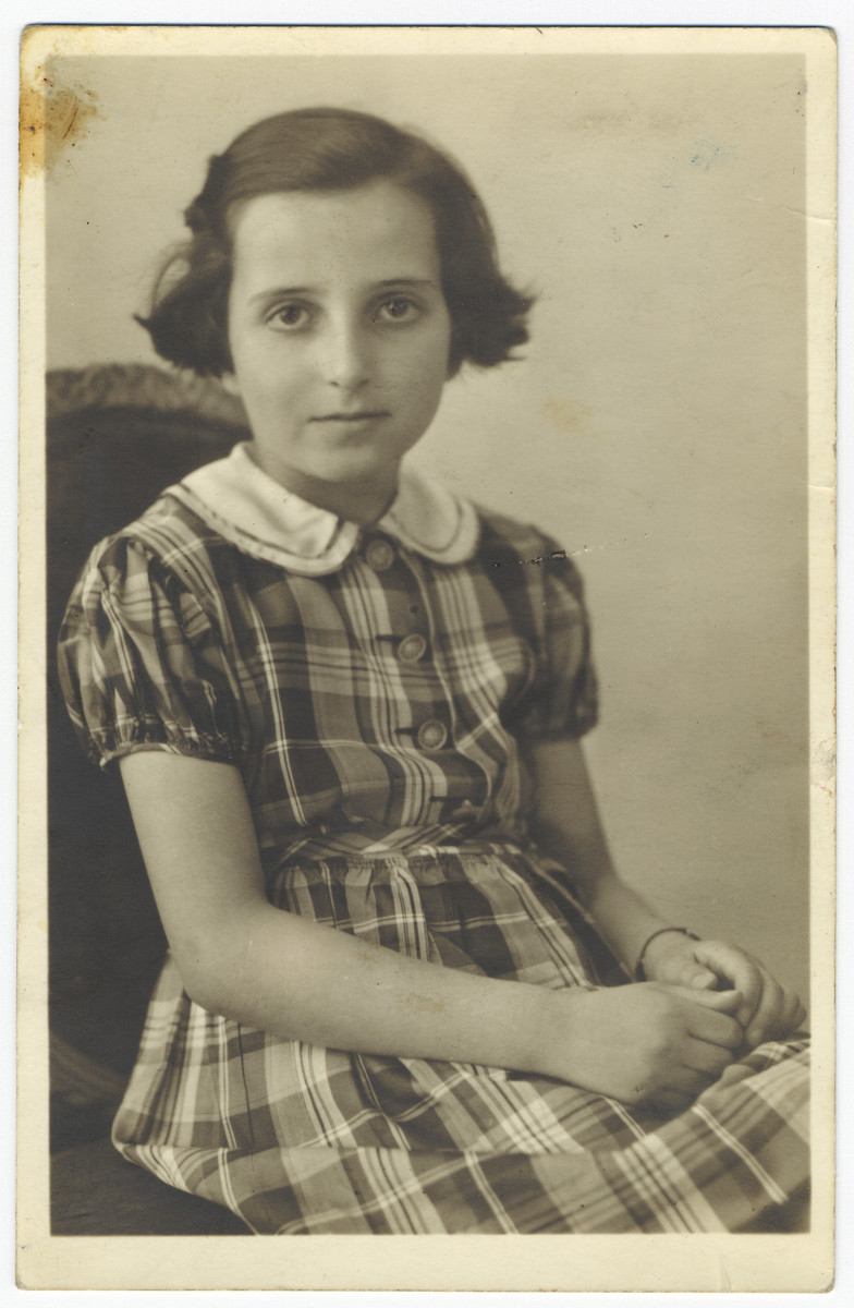 Studio portrait of a Jewish girl in Duesseldorf taken shortly before the start of World War II.  Pictured is Ursel Heineman.  Her fate is unknown.