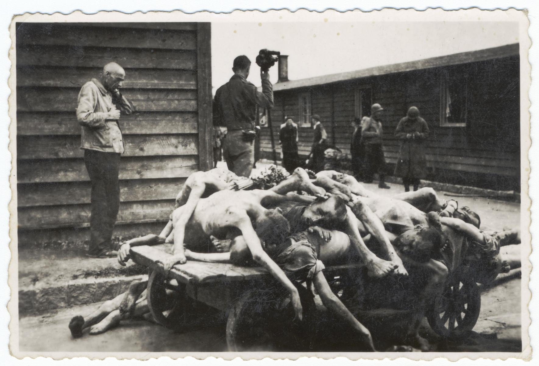An American signal corps photographer films the clearing of piles of corpses in the Gusen concentration camp.