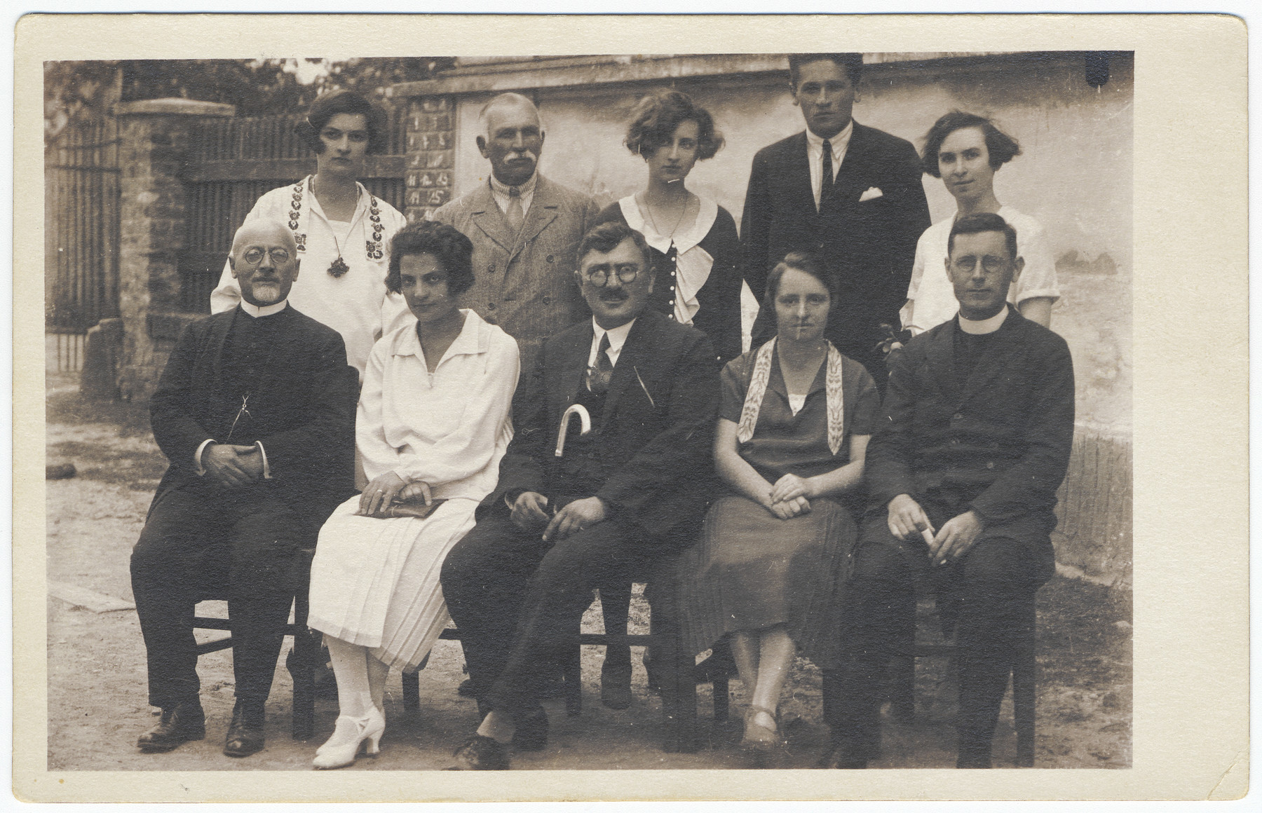 Teachers in a school in Ludbreg.  Pictured seated on the left is Rabbi Leopold Deutsch and seated on the right is a priest.  Both taught classes on religion.  Seated in the center is Miskulin, the music teacher.