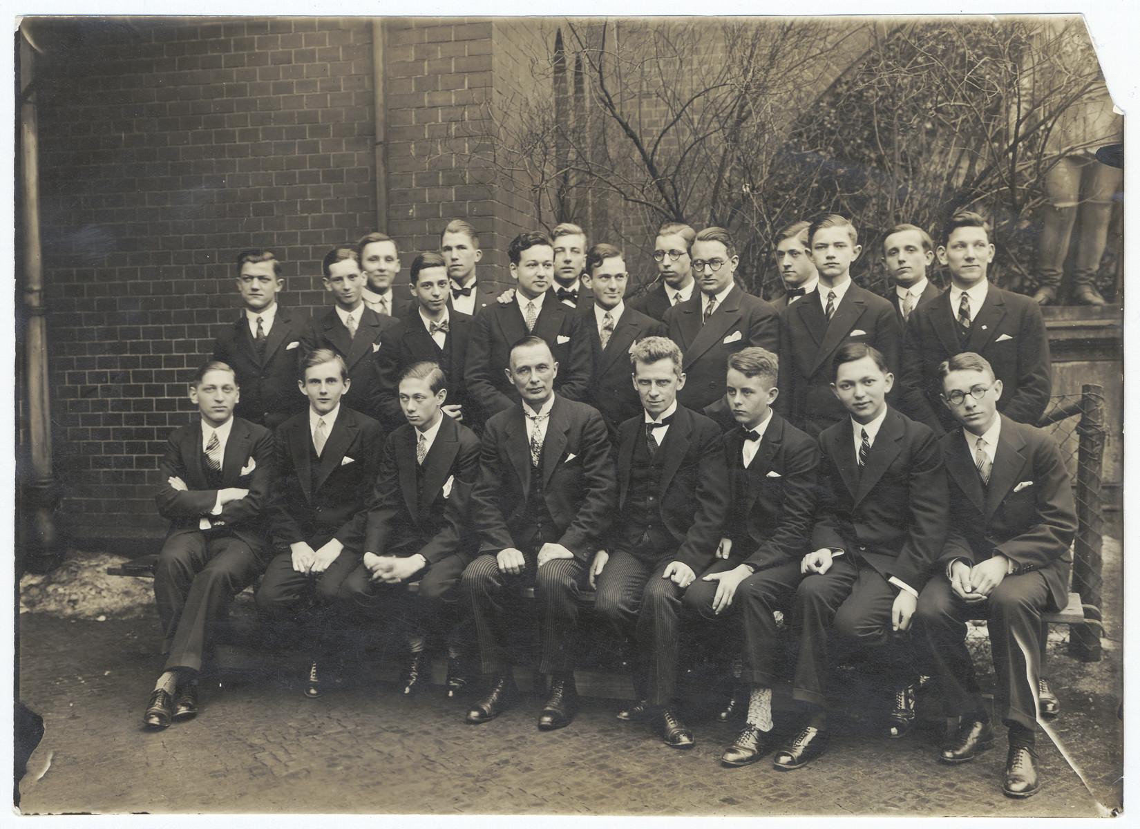 Group portrait of school students after their abitur.  Among the pictured are (left to right):   In the last row, standing: Heinz Panteleit, Walter Alkan, Klaus Bruening, Gerhart Riegner, Herbert Koeker, Kurt Bieber, (...) von Holleben, Erwin Japka, Asver von Braudt, Werner Peter Kahn (wearing glasses), Emil Eckstein, Kurt Panteleit, Gerhard Loeper, and Wolfgang Fleck. In the first row (sitting): Klaus Rosenthal, Joachim Ackermann, Gerd Wolfson, Direktor Voigt, Studienrat Remm, Werner Fuerst, Heinz Pinkus, and Dietrich Frohmann.