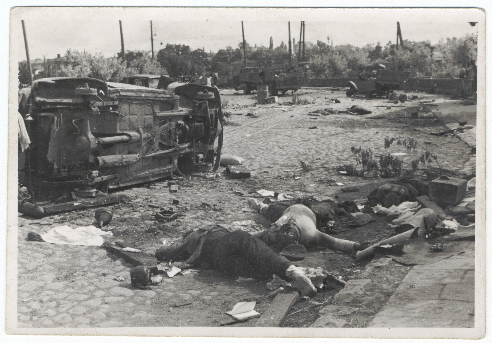 Corpses and burned out military vehicles lie near a train track following a battle [probably during the German invasion of the Soviet Union].