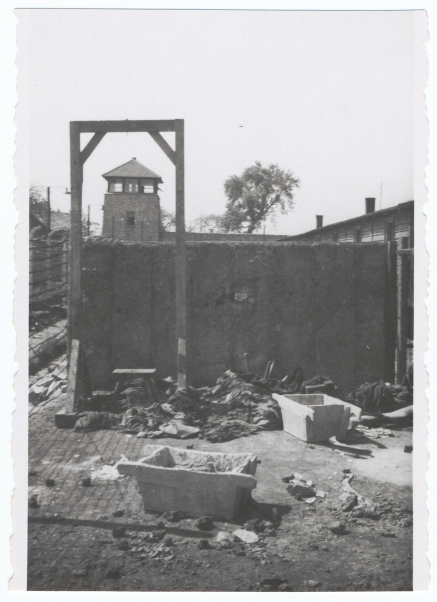View of the gallows in front of an execution wall and watch tower in the Gusen concentration camp.