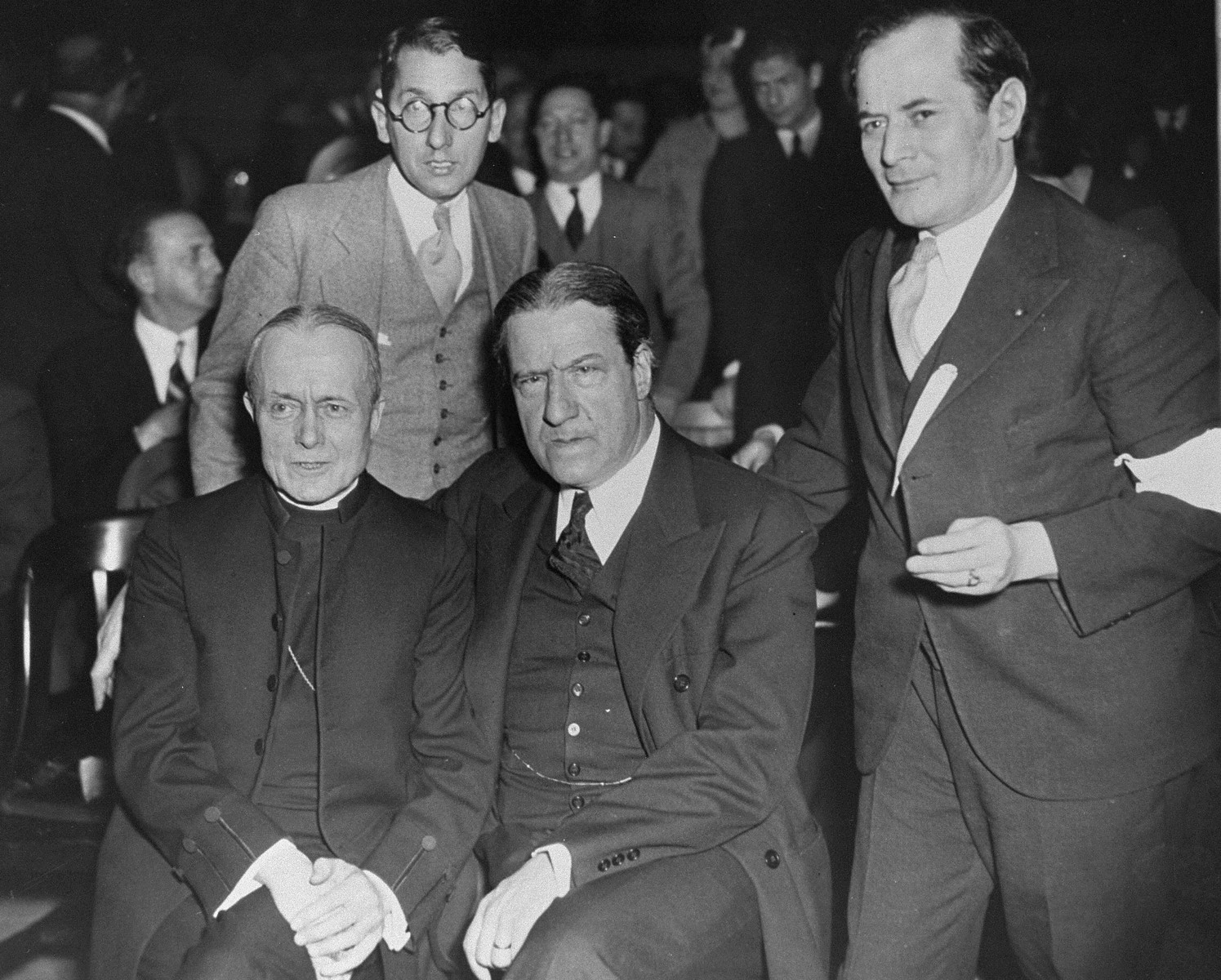 Bishop William T. Manning (lower left) and Rabbi Stephen Wise (center) attend a mass rally at Madison Square Garden to protest against the enactment of anti-Jewish legislation by the Nazi regime and the acts of terror and incitement against German Jewry perpetrated by the new government.