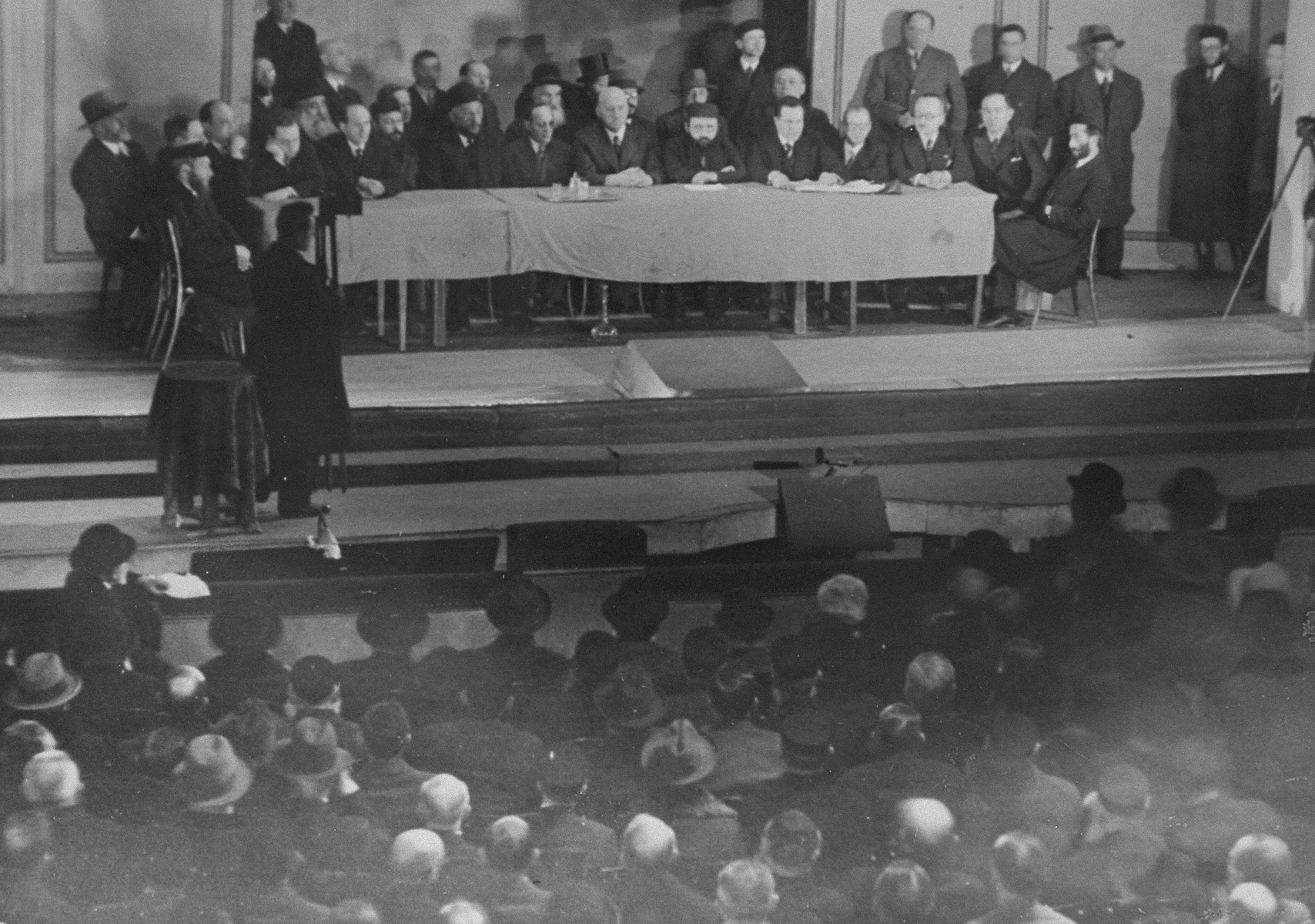 View of the speakers' podium during a public meeting to protest the enactment of anti-Jewish legislation by the Nazi regime in the Jewish Theater in Warsaw.
