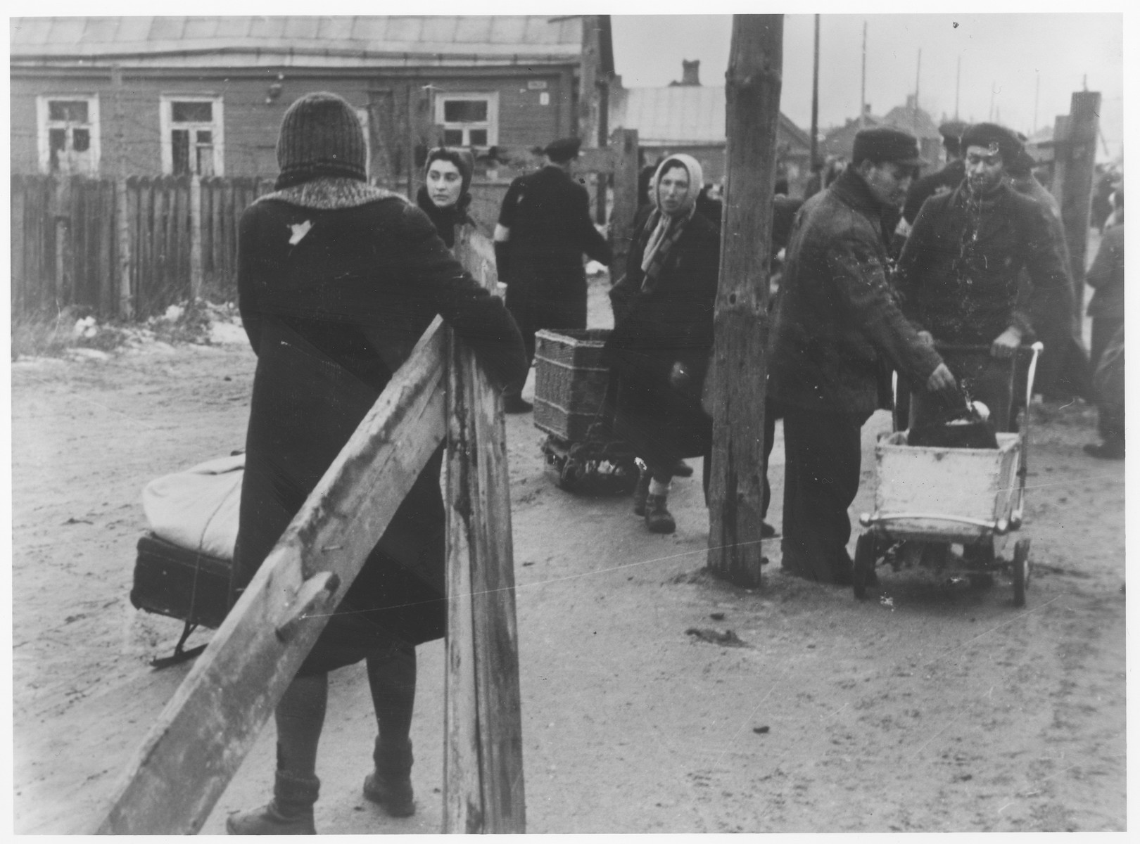 Jews are gathered near one of the entrances to the Kovno ghetto while moving their belongings into the ghetto.