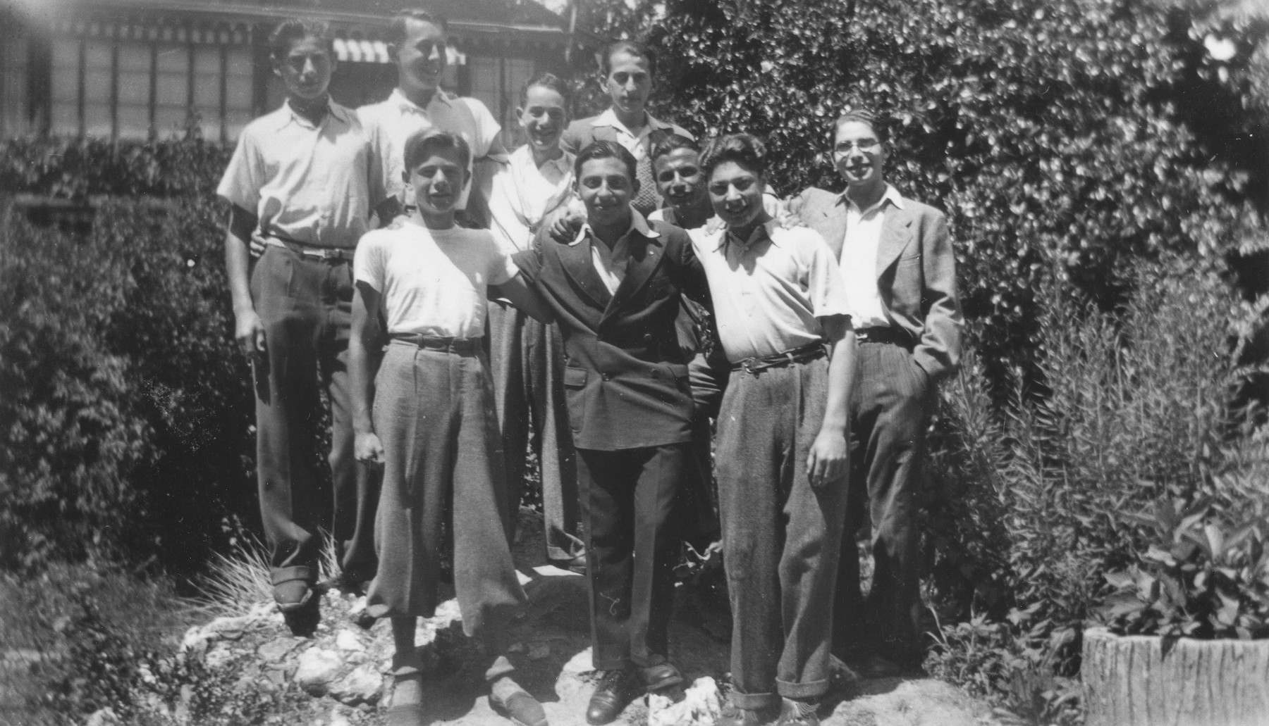 Group portrait of Jewish youth living at the Hôme de la Forêt children's home in Geneva, Switzerland.  Among those pictured are Gérard Alexander, Norbert Bikales, Heinz Diewold, Alex Kramskoi, David Hirsch and Walter Herzig.