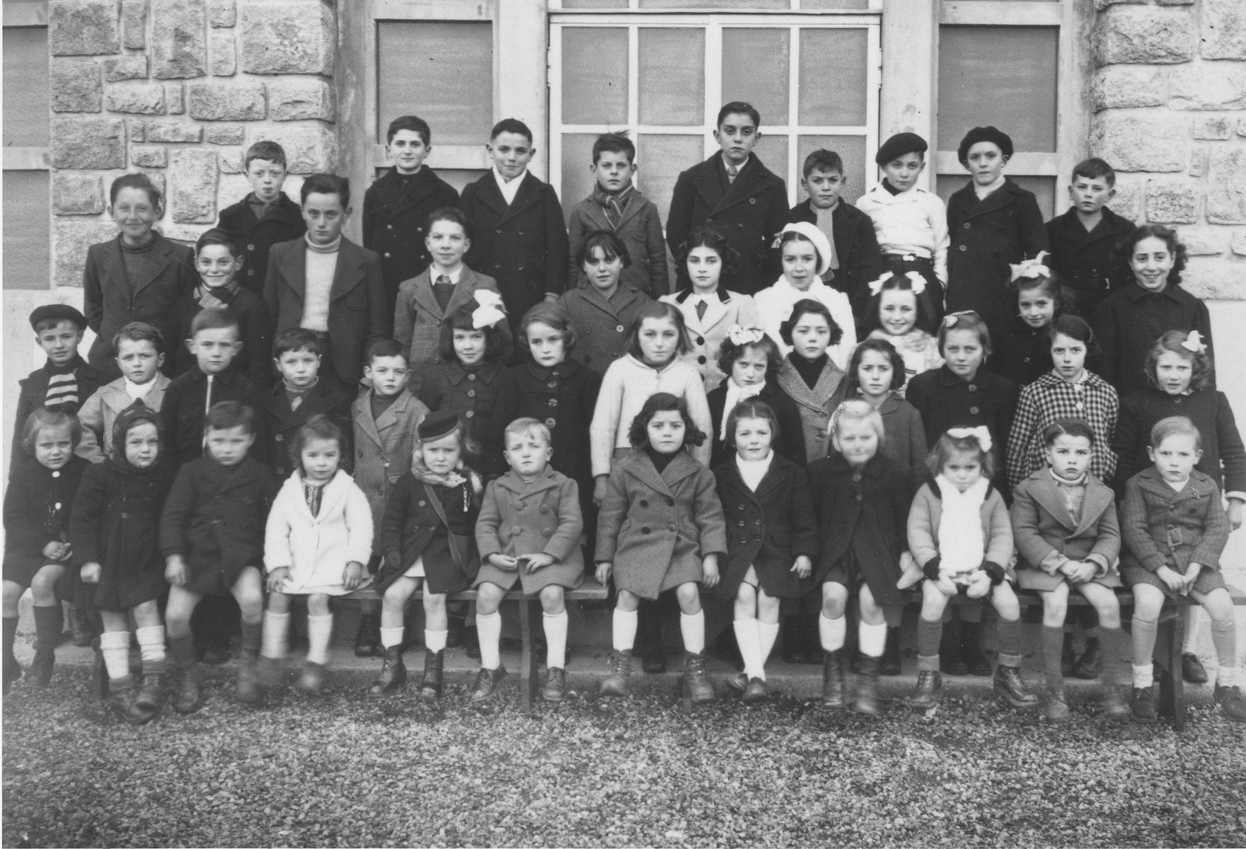 Ruth Zarnicer (third row from the front, far right) poses with her classmates in the Jeanne d'Arc convent school, where she was hiding under the name Rene Latti.