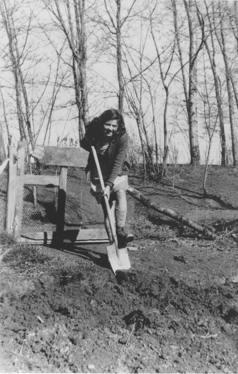 Ingeborg Haas digs in the garden of the Chabannes children's home.