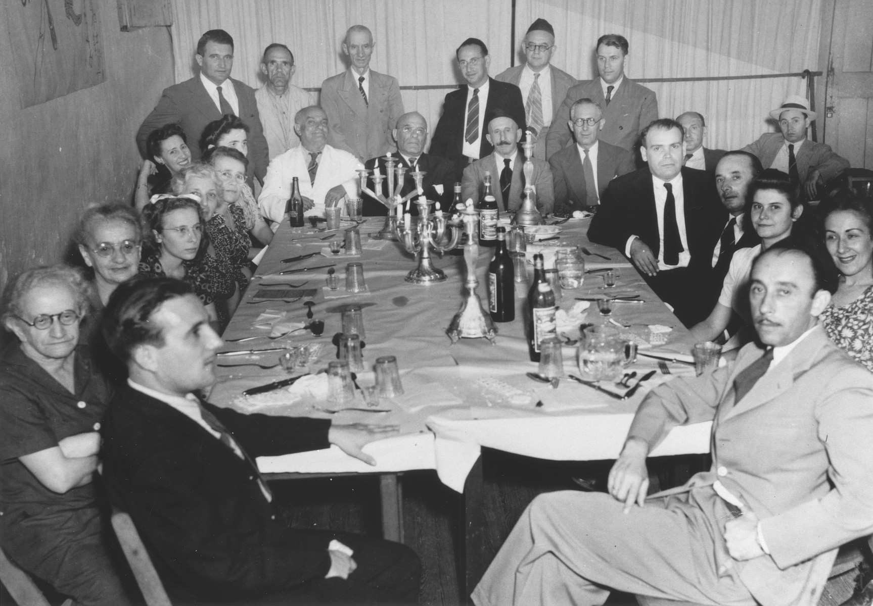 Jewish refugees attend a seder in Santo Domingo.  Morek Morsel is seated at the front, right.