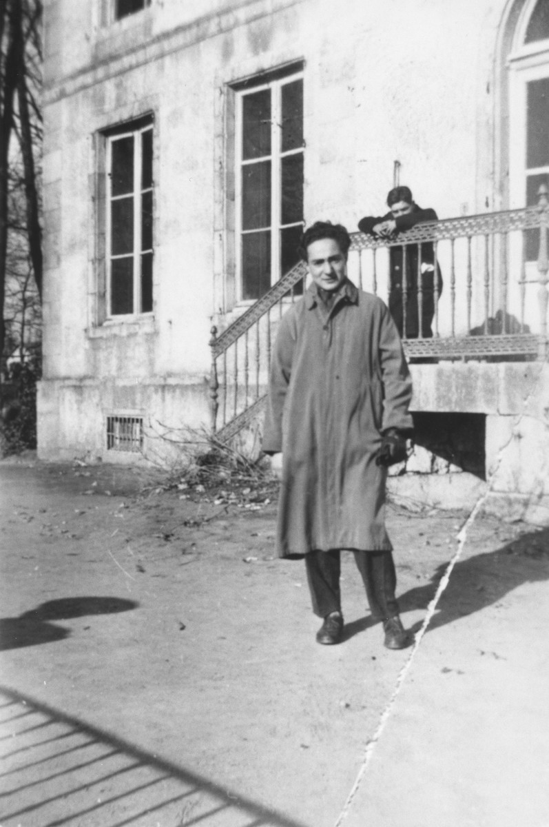 Hugo Zarnicer poses outside the Poulouzat children's home.  The home was sponsored by the OSE (Oeuvre de secours aux Enfants).