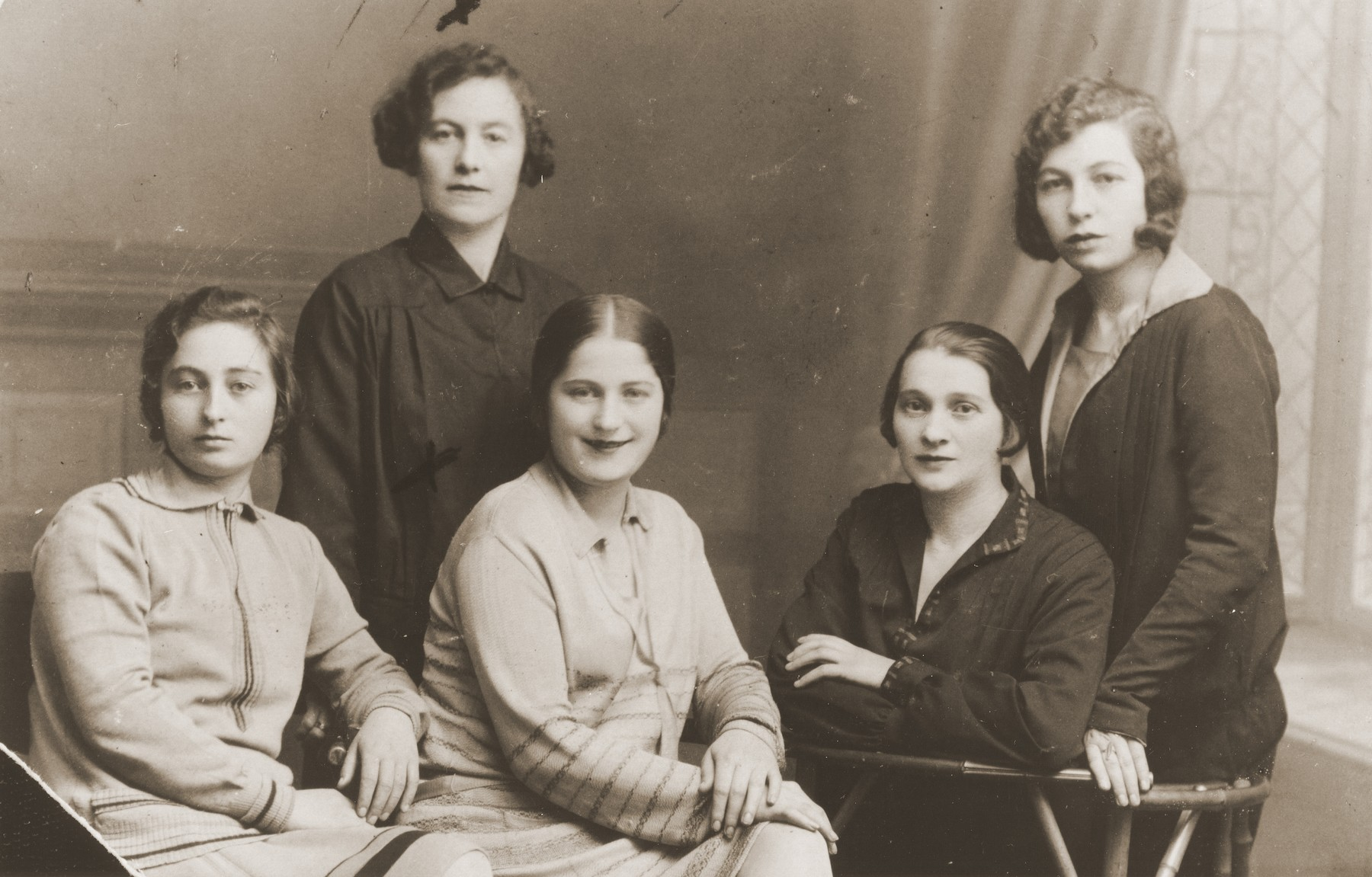 Studio portrait of Jewish cousins in Goloby, Poland.  Pictured are Tzena  Leikach (far right), Eta Leikach (far left) and their cousins Leah Guss and Clara Erlich.
