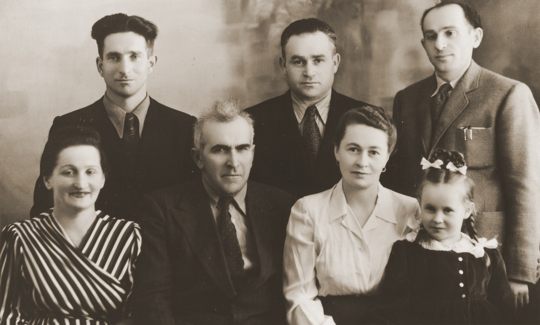 Studio portrait of Jewish DPs in the Cremona displaced persons camp.  Among those pictured are: Nachem Milstein, Chaim and Chaika Katz, Aaron Pelc, and Motel, Zelda and Masha Leikach.