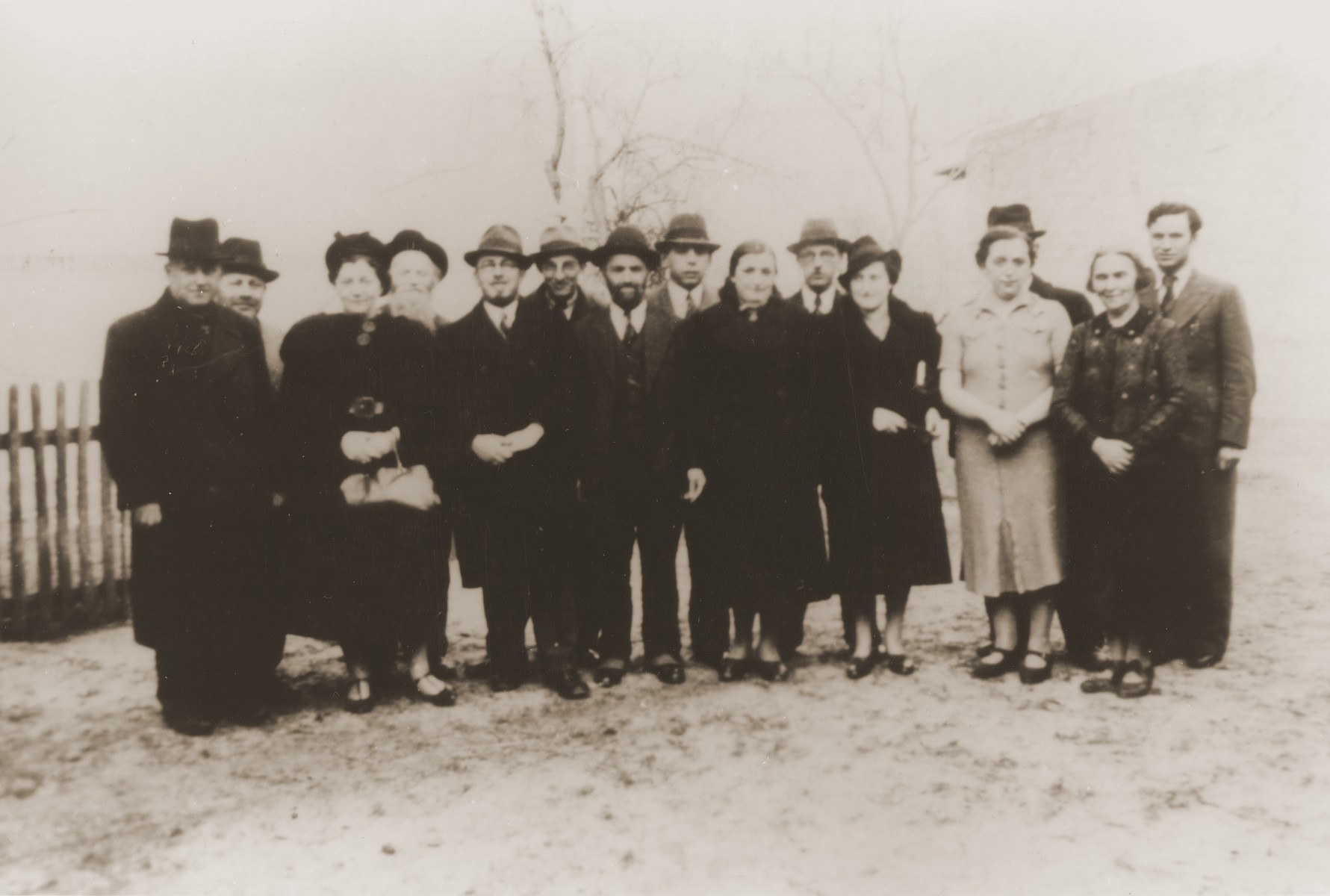Group portrait of Jews of Polish nationality (relatives of the donor) who were expelled from Nuremberg to the Polish border town of Zbaszyn.  Pictured from left to right are: Leo Fallmann; Rosa Fallmann; Mr. Auerbach; Mr. Zahn; unknown; unknown; Chaim Kupfermann; Anni Kupfermann; Simon Wassermann; unknown; Regina Holzer; and Bertha Holzer.