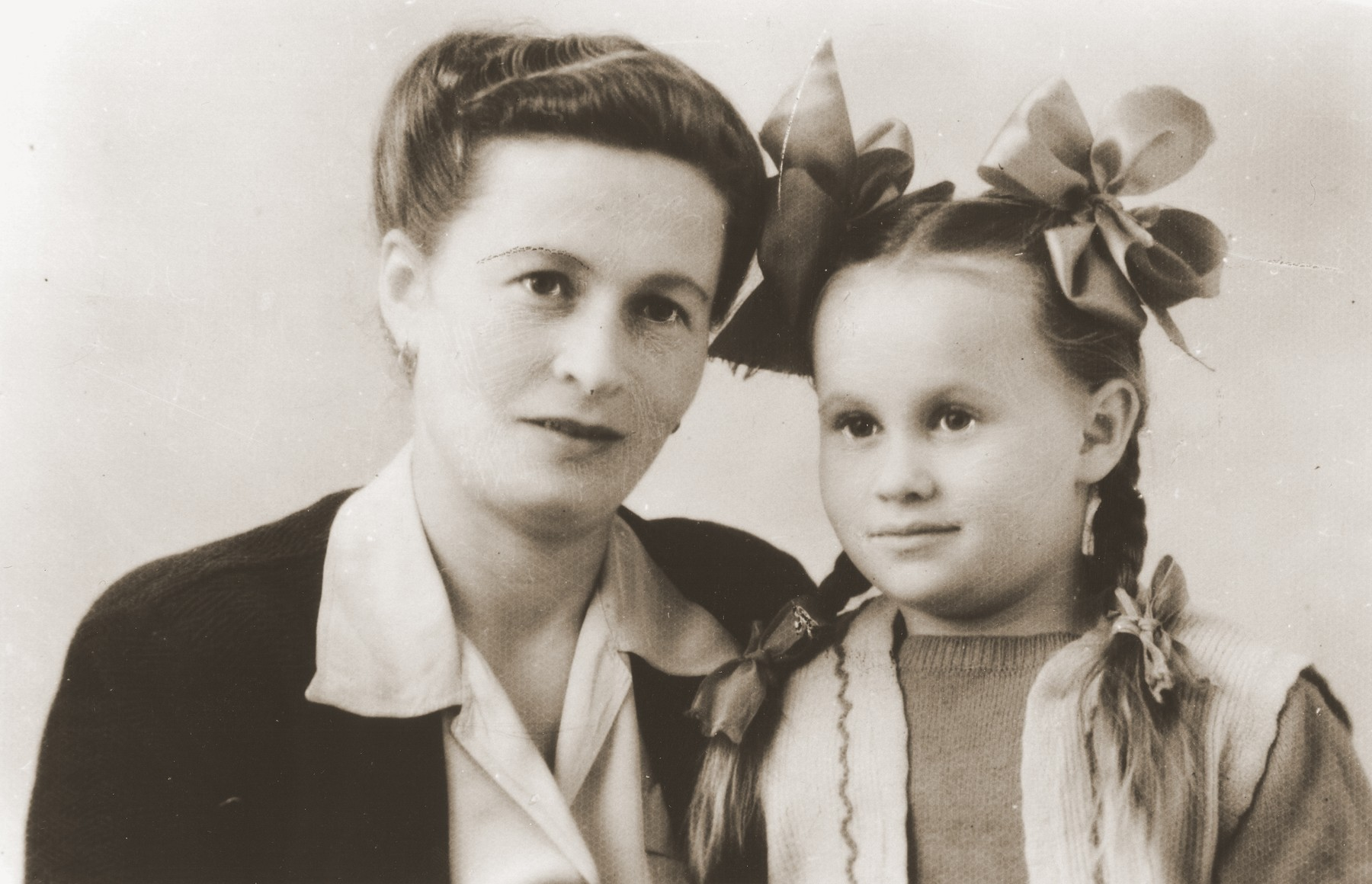 Studio portrait of a Jewish DP mother and daughter in the Trani displaced persons camp.  Pictured are Zelda and Masha Leikach.