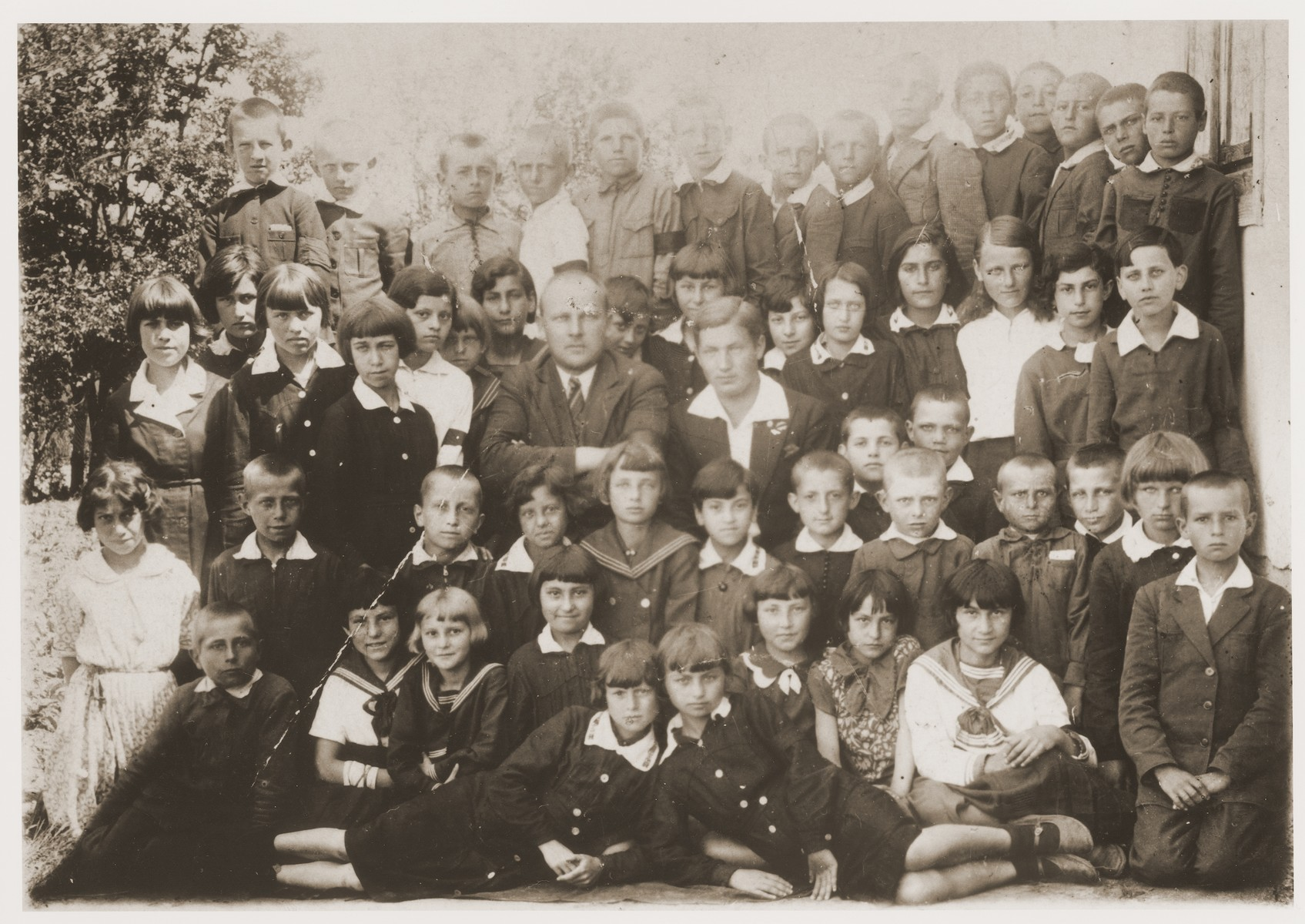 Group portrait of students at the elementary school in Kowel, Poland.   Nachman Pinsky, the donor's cousin, is seated in the front row, third from the right.