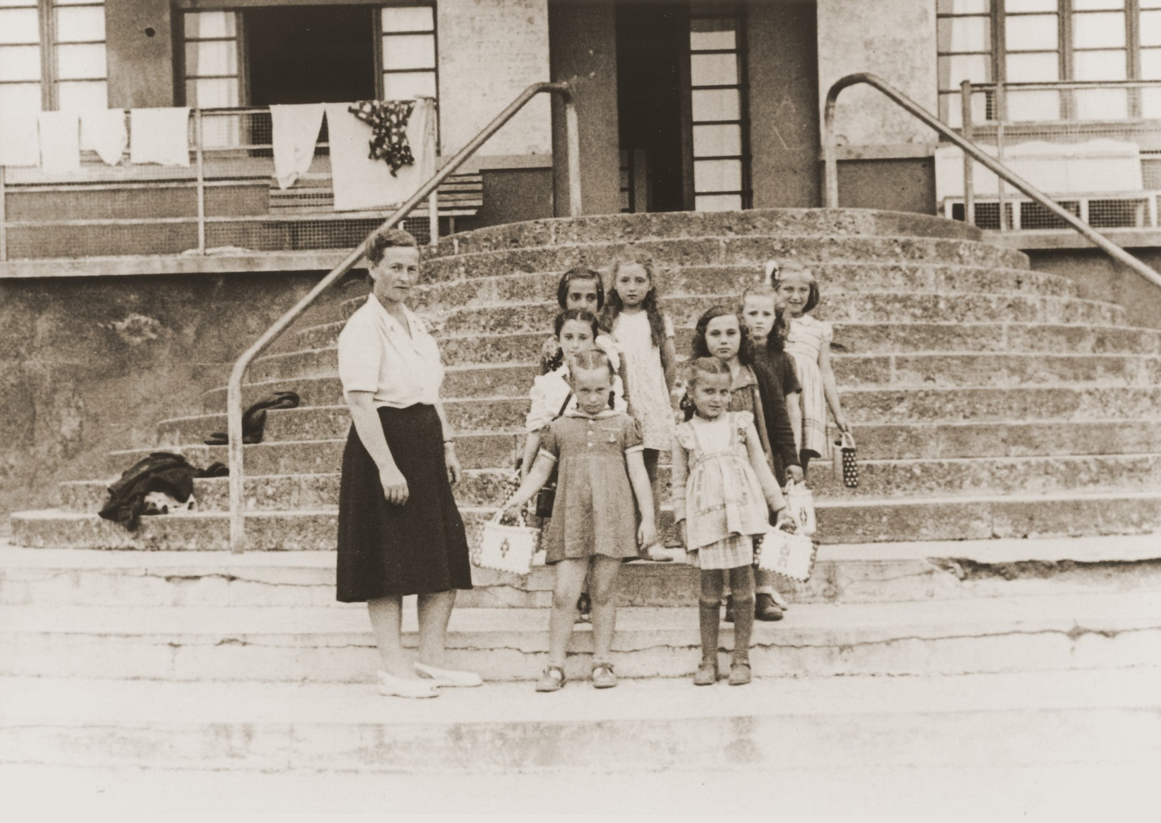 A group of Jewish DP children from Cremona on a visit to Selvino.  Among those pictured are Zelda Leikach (standing on the left) and her daughter Masha next to her.